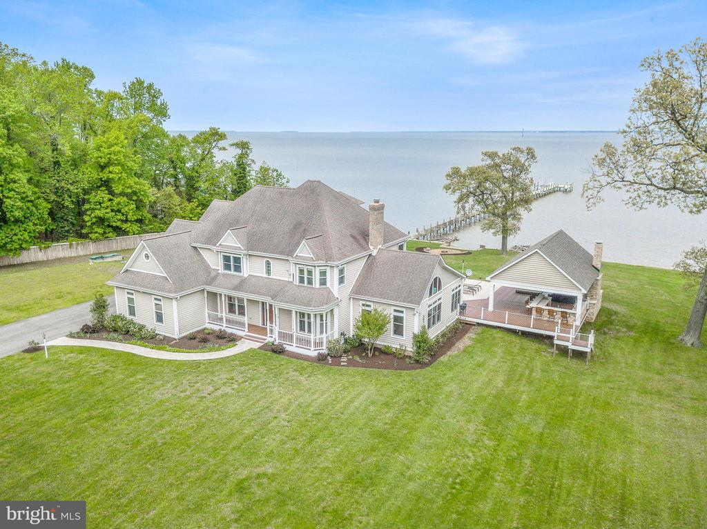 Gorgeous five acre equestrian waterfront estate with panoramic views of the Chesapeake Bay.  In addition to the stunning remodeled 5600 sq. ft home (tax record incorrect) this property includes bulkhead, pier, private beach, in-ground pool, pool house, new large pavilion with outdoor kitchen, stacked stone fireplace and 6 person hot tub.  There is also a private guest house, horse barn/stable, shed/workshop, whole house generator and newly built natural stone fire pit.  It's your own very private retreat for fishing, boating, crabbing, entertaining all in a breathtaking waterfront setting.