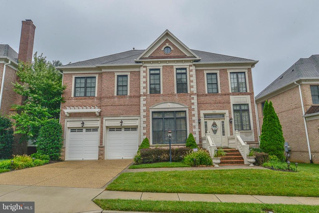 Dressed to impress! No detail overlooked. $200K+ in builder upgrades. Perfectly located: minutes to Mosaic, Dunn Loring & Greensboro Metros, Tysons, Town of Vienna. Crown molding, custom millwork, coffer ceilings, top-of-the-line chef's kitchen, open floor plan. Sanctuary mstr BR w/ fireplace, mini bar, sep sitting room, spa-like mstr bath. Amazing bsmt, bar, theater, exer rm, in-law suite & more!