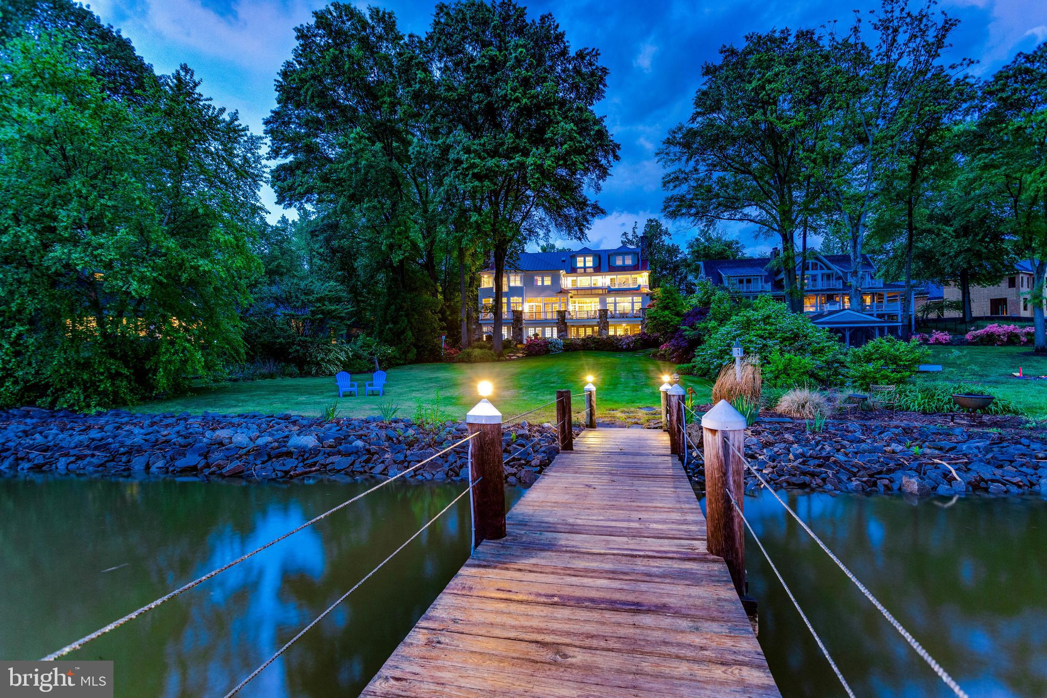 At 5229 Burke Drive the everyday is extraordinary. A home unlike any other, this custom designed waterfront home is a true oasis; a home that provides for endless fun and adventure also evokes an everyday inner peace and quiet. Watch your yard come to life with every color imaginable in the spring, play hockey on a frozen river in the winter, throw the BEST fourth of July party in all of Alexandria in the summer, and when the first cool day arrives in the fall know that the magic of nature is just beginning. Enjoy your morning coffee while watching deer across the river take their morning drink, become best friends with a Great Blue Heron who finds refuge on your dock, get out on the water and boat every day. This home was built to allow you to live life to the fullest, this a home is meant to be enjoyed by many, this home will be your happy place. Unparalleled water views from every room in the house. 5 Bedrooms, 5 full and 2 half baths, a completely separate au pair/in-law suite above the garage, 2 full kitchens with top of the line appliances. Wall to wall windows across the back of the house.