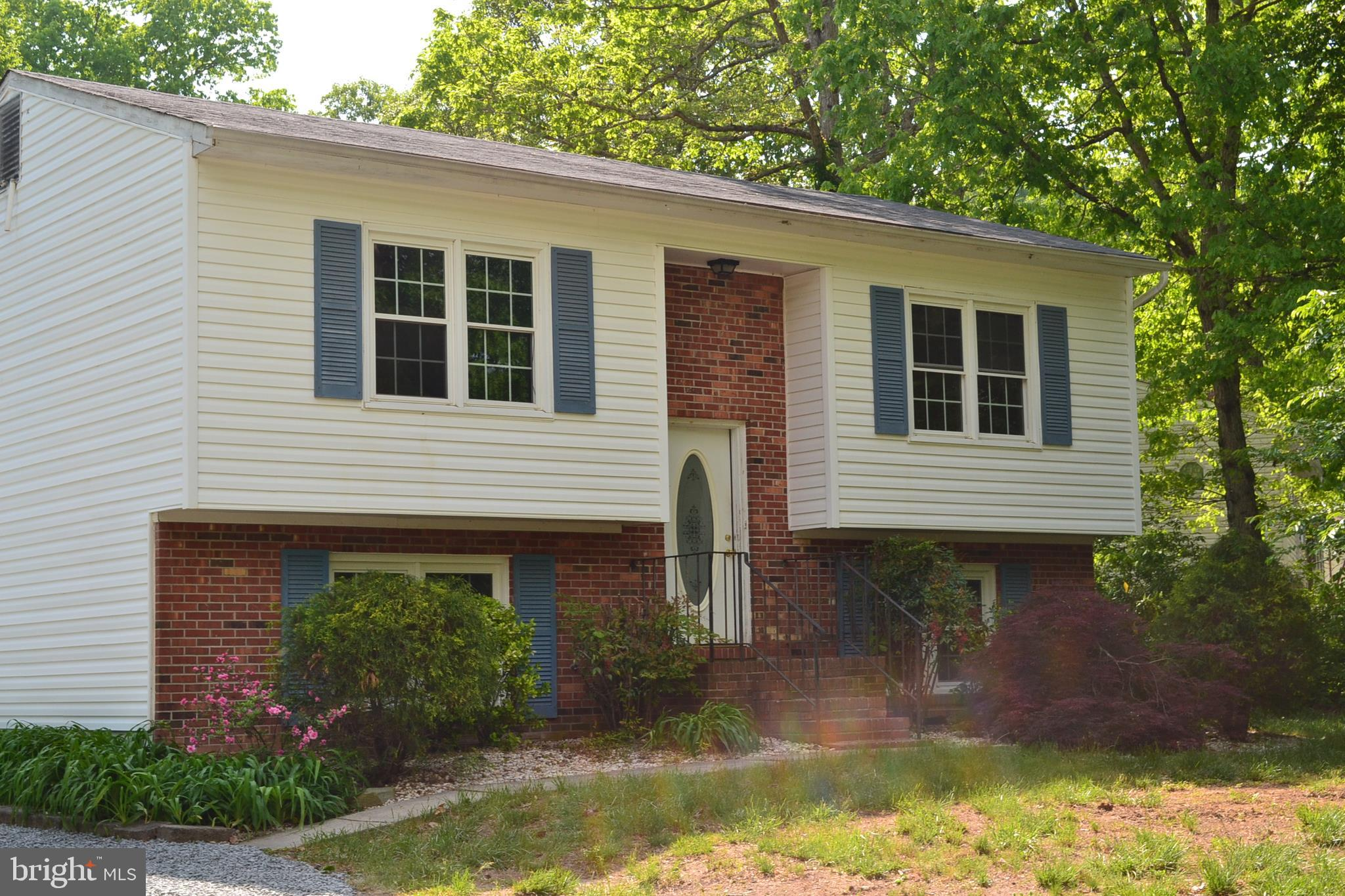 UNBELIEVABLE VALUE and over 1,700 square feet of living space!!  Freshly painted and move in ready!  Updated laminate flooring throughout the home.  Galley kitchen with smooth top stove and microwave, separate dining space off kitchen with a slider to wood deck off back of the house.  Open living room and dining area. Spacious family room on lower level with recessed lighting.  Fully finished lower level with walkout and full bath.  Situated on a corner lot with large driveway with lots of parking space and shed.
