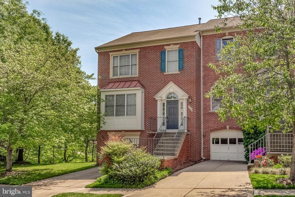 Luxury Brick End Unit Garage Townhouse with 3 finished levels, 3 Bedrooms, 2 Full & 2 Half Baths.  Skylights, Fireplace, Nine Foot Ceilings, Sliding Glass doors to Deck. Great Location.