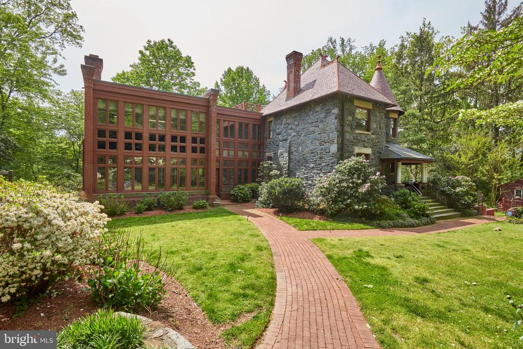 Exciting opportunity to own a STONE CASTLE, built circa 1890, close to DC with a 2 Bedroom Guest House.  Completely renovated, reimagined and expanded by renowned DC builder and architect Clarence Kettler in the late 1980s as a personal residence. The main house features 5 Bedrooms, 4 Bathrooms, 2 half baths, ELEVATOR, Chef's Kitchen, 3 Decks, Winter Potomac River Views and attached 2 Car Garage, with 4 Bedrooms and 3 Baths, including the Master Suite, on the second level. The third level features a Bedroom, Bathroom and Play Room with access to a ROOF DECK with fabulous views. The lower level has a Billiard Room and Study.  The Elevator accesses three levels.  A UNIQUE and SPECTACULAR one-of-a-kind offering. This property is one of three Stone Castles built by the Baltzley Brothers, who envisioned these houses in Glen-Echo-on-the-Potomac, also known as the ~Washington Rhine.~ The stone for the Castles came from local quarries operating on Seven Locks Road.  The Brothers also built the Glen Echo Railroad to provide access to the nearby Glen Echo Amusement Park (which was constructed using the same stone).  Sold as is.