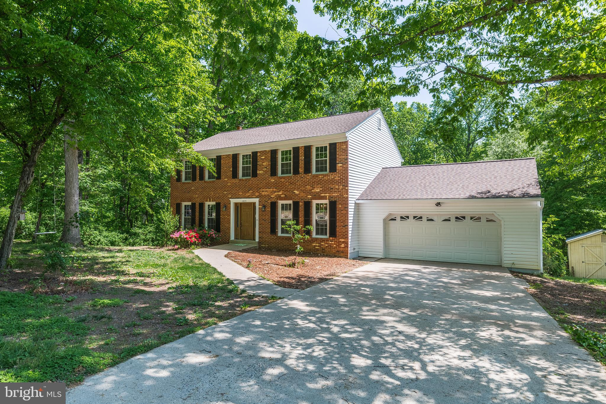 Looking for a different lifestyle away from the hustle & bustle of urban living.  Here it is!  Tucked away on over an acre of lush country living, this beautifully remodeled colonial is oh-so-close to Potomac Mills Mall, historic Manassas & Occoquan & easily within striking distance of Alexandria & DC! Walk, bike or drive to the nearby grocery story & local restaurants & enjoy easy access commuter options! Slip through the front door & fall in love with the neutral Pottery Barn interior filled with fresh custom paint, plush new carpet & gleaming hardwood floors! Entertain in the formal living & dining rooms or relax in the cozy family room! Prep for a party in the spacious kitchen replete with gorgeous granite counters or enjoy movie/game night in the lower level Rec Room offering a cool bar area & second fireplace!  Dream the day away on the spacious deck overlooking a secluded yard! And do whatever the heck you want in this non-HOA community!