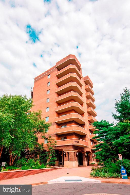 This spacious luxury condo is ideally situated 1/2 block to the Ballston Metro, between natural green space and a quiet neighborhood.  Enjoy views of the park from your living room and balcony.  The kitchen has stainless steel appliances, plenty of counterspace, and a large pantry for added storage.  Eat at the breakfast bar or in the dining room area.  The large open floor plan makes entertaining easy. The sunny living room features a large picture window, a gas fireplace, and access to the sun-filled balcony.  The master bedroom includes a walk-in closet and master bath with double sinks. The den has a walk-in closet and bathroom access, giving the option of a second master bedroom.  Ballston Park amenities include an immaculate fitness center, a party room, and shared outdoor space.  This condo includes TWO assigned parking spaces and a large storage unit. Bike storage is also available. Enjoy all the restaurants and shopping that Ballston has to offer from this great location.