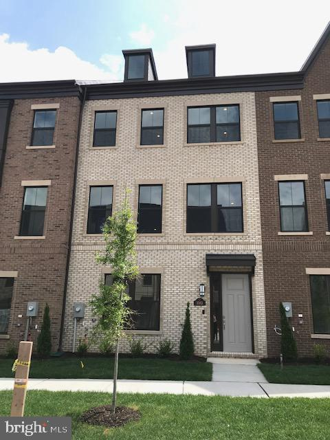 Gorgeous brand new 4 level town home in a fantastic location. Contemporary finishes include Sonoma Painted White shaker style cabinets, granite countertops, hardwood floors and oak stairs, backsplash and all upgraded appliances.  Fireplace and Bookshelves in Family room.  3 bedrooms with 3 baths and 2 powder rooms. Spacious loft with rooftop terrace & Amazon Home Automation Package! This one is a must see. Prime location and close proximity to Dulles Airport, 28, 267, 50, 66, and short distance to Silver Line Metro!!!! Plus Closing cost assistance!