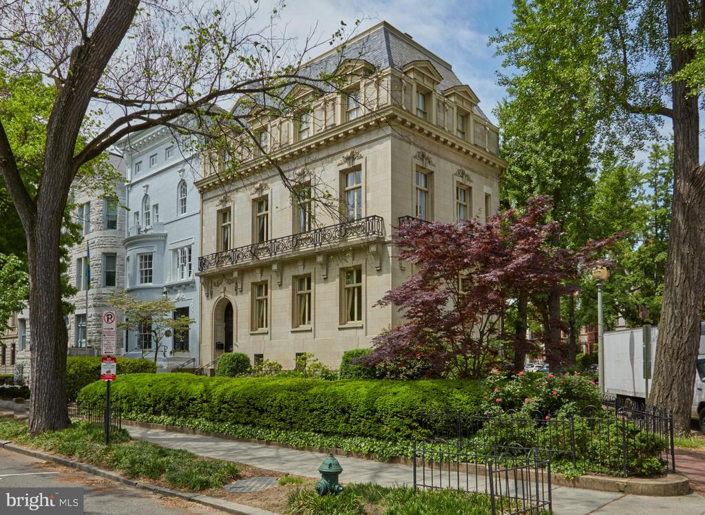 Showings by appointment only. Historic home in the heart of Dupont Circle. The home was constructed of stunning tan limestone in 1910, by noted Washington architect, Clark Waggaman, for the niece of President Van Buren. It is a superb example of the Louis XV style balanced skillfully with Louis XVI details. The principal chambers, the entrance vestibule, stair hall, drawing room, reception and dining rooms are all connected by glazed ~French~ doors. The same hardware, architraves, moldings, overdoors and elaborate cornice are consistent throughout. Grand entrance hall features a three-story staircase accented by the original wrought iron balustrade overlaid with gold leaf. Drawing room baseboards and Louis XVI mantle in Sienna marble. Dining Room features a Louis XVI faux marble fireplace (one of six in the home). Elegant library in the French Renaissance style with beamed ceiling, and features Phillipine mahogany bookcases and a floor to ceiling limestone fireplace. Exquisitely renovated and thoughtfully preserved home registered with the National Historic Trust. Beautifully maintained front garden parkway, hedged to the property line, with in-ground irrigation and watering system. Secret staircase from the basement leading to the front receiving hall. Convenient attached garage with interior entry. Within walking distance of all that Dupont Circle has to offer!