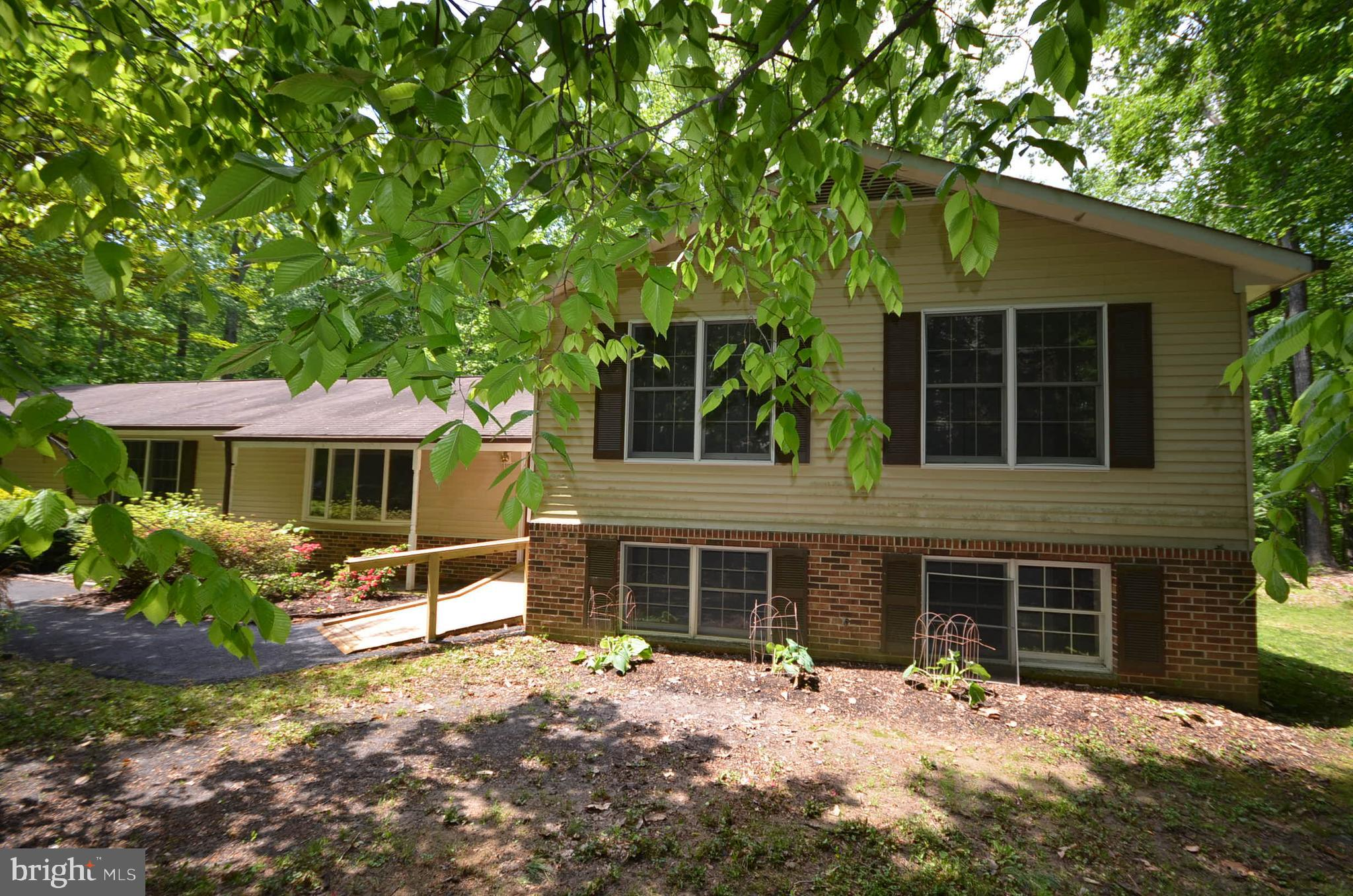 Single family 5 bedroom, 3.5 bath home that contains 2,099 sq ft and was built in 1984. New carpet and paint throughout. Private, wooded yard with large back deck and screened back porch. Updated kitchen with stainless steel appliances.
