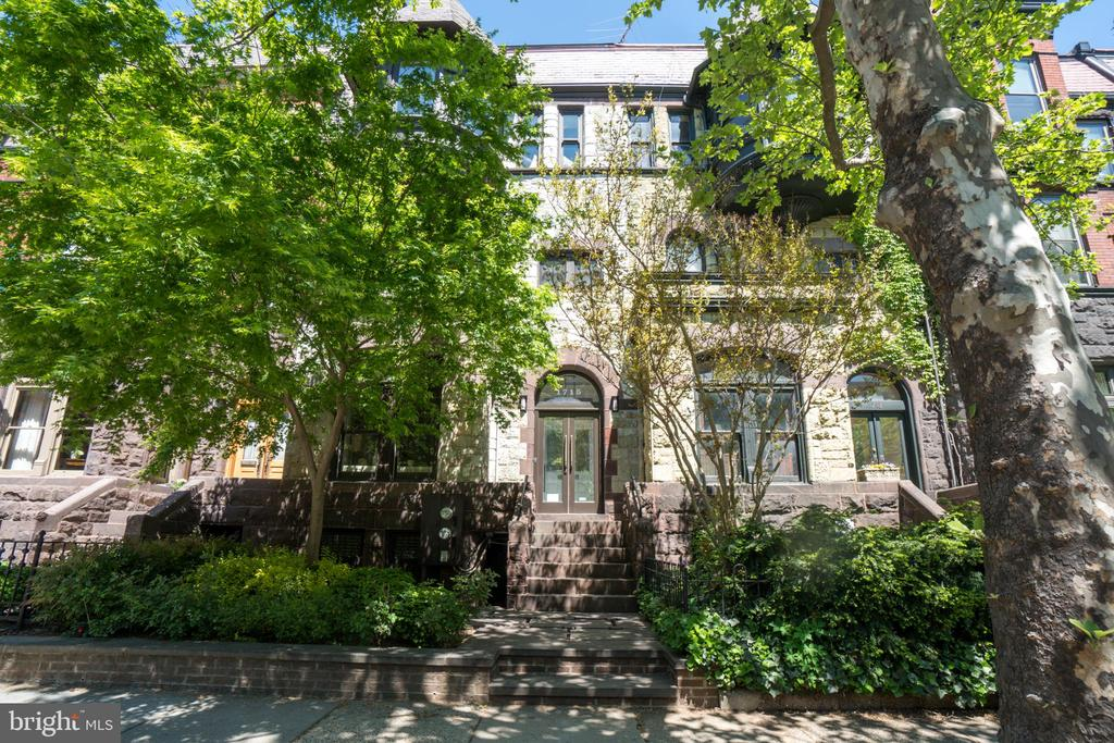 "This stunning T.F. Schneider designed Brownstone, located on one of Dupont Circle's most prestigious blocks, is truly a one-of-a-kind masterpiece.  Built circa 1880 and thoughtfully renovated, it was redesigned for today's lifestyle by nationally renowned designer Lori Graham. This elegant home is suitable for even the most discerning buyer.Perfectly blended period and modern details can be found throughout the home including custom plaster ceiling moldings, a gas fireplace with inlaid marble surround and a beautiful chef's kitchen.  Complete with custom cabinetry, honed statuary marble countertops, a ""Pro 48"" Sub-Zero refrigerator, a Viking range and a hidden paneled door that opens to a large pantry room, no detail has been spared.  The dining room, ideal for hosting large-scale dinner parties, features classic pocket doors, a gas fireplace and custom drapes. Meticulous details continue on the second level where a soundproofed laundry area with oversized washer and dryer is situated between two well-appointed suites.  Spanning the entire third level is another, extraordinary suite,  features a sitting room, an additional kitchen with top-of-the-line appliances, as well as a massive bathroom with ebonized oak custom tumbled Nero-Marquina marble tile floor, separate vanities, soaking tub and shower. The sitting room of this jaw-dropping suite has 22' vaulted ceilings, floor-to-ceiling bookshelves with library ladder and four large custom skylights. Take the elevator up to the stunning two-level 600+ square foot deck that includes multiple seating areas and storage.The large lower one-bedroom apartment can be used as a separate income unit or additional living/guest space. Situated on a deep lot, the property allows for a back deck off the dining room and a fenced back patio for more outdoor entertaining space.  Additional features include a Sonos systems with cameras, speakers, and wireless thermostats.  Two car private parking rounds out this remarkable property."