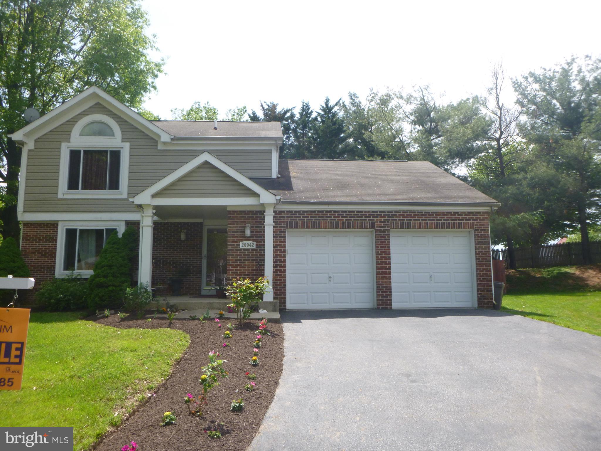 2 GARAGE,UPDATED KITCHEN ,UPDATED BATHS,CROWN MOLDING DINING ROOM AND LIVING ROOM CEILING.