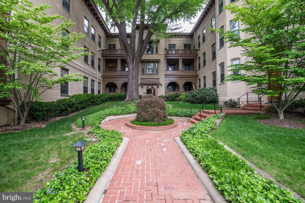 Rarely available condo in the historic Downing & Vaux. Elegant space w/high ceilings that includes an expansive open floor plan, living room w/fireplace and dining room with 2 sets of French doors (w/screens) opening to a large veranda overlooking the 30th St. courtyard. Filled w/natural light from N, W & E exposures. Both bedrooms are generous and have extensive closet space. Built-in bookcases & a wall of cabinets in living room, and separate storage unit included. Pets permitted. One block from market/dry cleaners, pharmacy & bus - all in the heart of Georgetown.