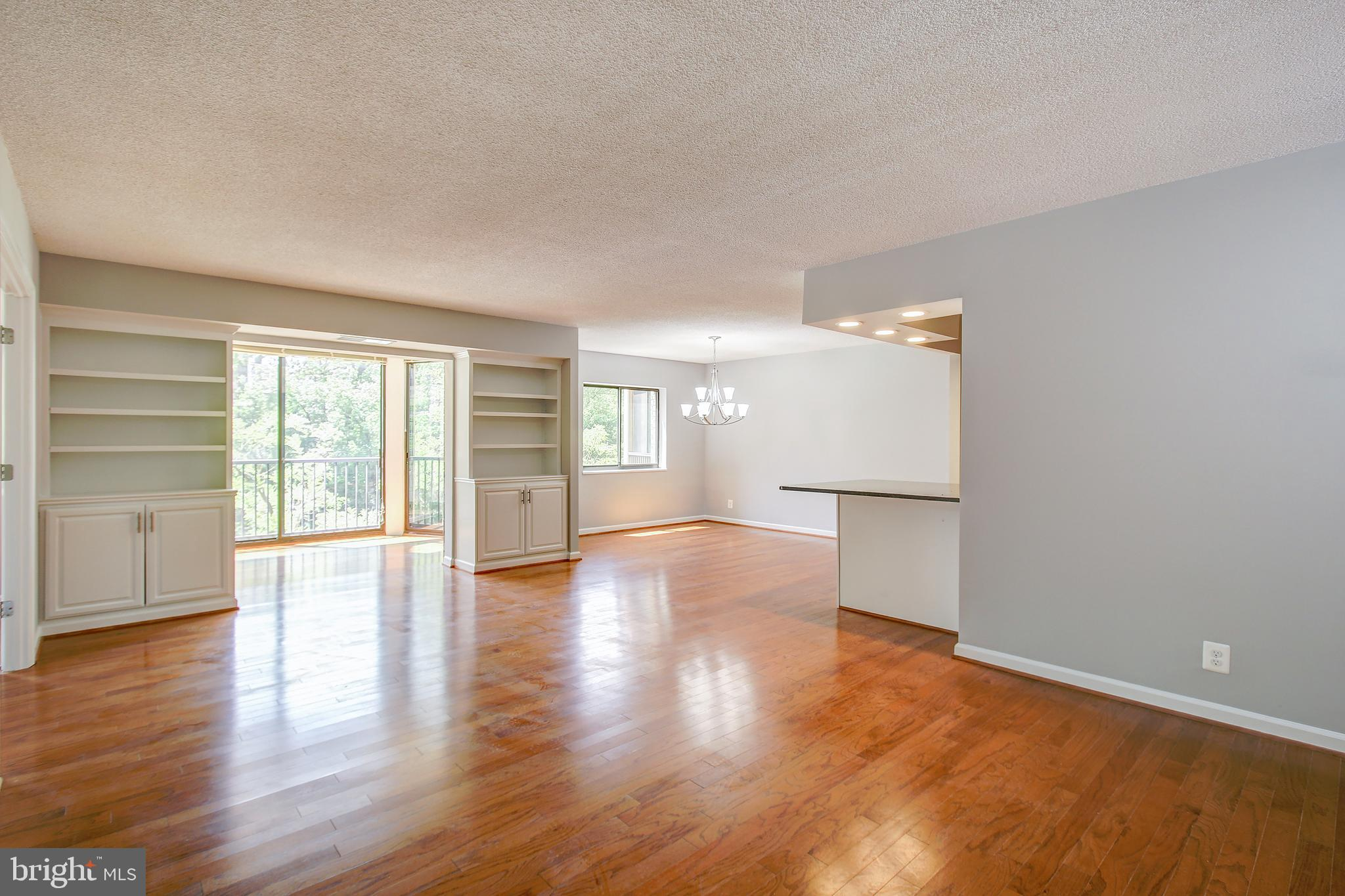 """***** NEW LISTING! ***** Go see the rest, then come see the best, -- it's like moving into a """"BRAND NEW HOME""""! This beautiful Montebello home is in picture-perfect MOVE-IN CONDITION, -- ready for today's value conscious home buyer. Beautiful 2 Bedroom, 2 Full Baths home with 1,305 square feet of living space with OPEN KITCHEN concept! NEWLY RENOVATED THROUGHOUT, -- including ALL """"BRAND NEW"""" Kitchen, Baths, and Hardwood Flooring! All very UPSCALE/HIGH-END RENOVATIONS, -- including granite counter-tops, stainless steel appliances, and """"re-configured"""" Master Bedroom Bath. French doors pass-through from living room to 2nd Bedroom or Den/Study. Enclosed SUNROOM/SCREENED-PORCH has been opened to living room for your year-round enjoyment. GARAGE PARKING SPACE #94 conveying with premium location near elevator. Live at """"Award Winning"""" Montebello, -- the area's premier luxury condominium!   ***** SEE VIRTUAL TOUR LINK for """"Interactive"""" Floor Plan Tour and HD Video Tour! ***** IMPORTANT: Under """"Documents"""" icon, see detailed """"List of Features and Improvements"""", Property Brochure, and Floor Plan, -- or have your agent forward to you. *****"""