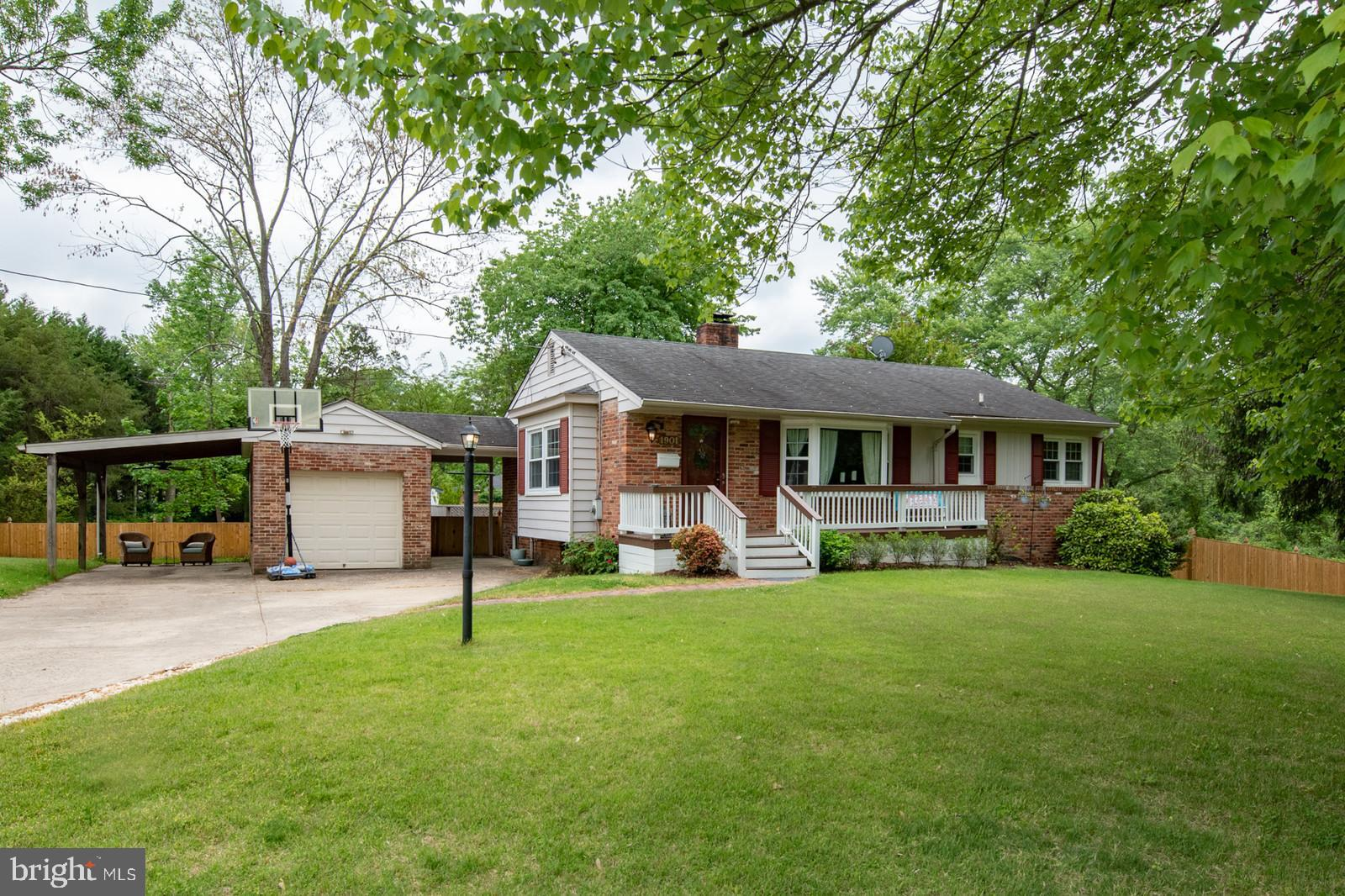 Large price adjustment! This two level home is larger than it looks.  Bring an Offer. New and improved in Waynewood school district.  Welcome to Paul Spring Parkway.  This Hollin Hall beauty sits up on a generous corner lot facing parkland and features four bedrooms and two full baths.  Recently and beautifully updated with a spacious newer (2017) kitchen with SS appliances, gas stove, tile floor, granite, breakfast bar and open to a bright living room;  enjoy entertaining in a separate, formal dining room;  other updates include the main bathroom, lower level bathroom with large shower stall and new tile flooring;  newer addition of charming front porch, bay window with window seat in the living room;  the bedrooms have been freshly painted, and the hardwood floors are gleaming on main level; enjoy two fireplaces - one gas, one wood-burning; double driveway with garage AND carport make parking a breeze.  Spend outdoor time on the private rear deck.  The back and side yards are fully fenced and there is a new storage shed; Walk to historic Hollin Hall Shopping Center with restaurants and shops; Close to Ft. Belvoir, Old Town and easy access to the Beltway.  11Y Bus into DC.  Home Warranty provided by Seller. Only 8 miles to new Amazon HQ, 4 miles to Ft Belvoir