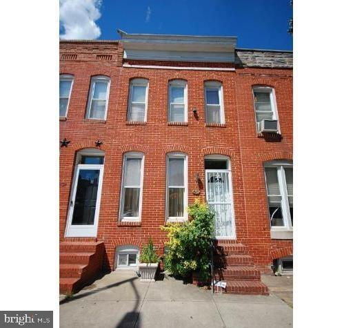 Spacious townhome in prime Federal Hill location with private gated parking! Hardwood floors on main level w/ open kitchen that leads out to a deck. Upper level features 2 bedrooms, both w/ large closets & a spacious bathroom. Lower level bedroom, rec room, full bath, laundry area & tons of storage! Walk out to your private gated parking pad that holds up to 2 cars!