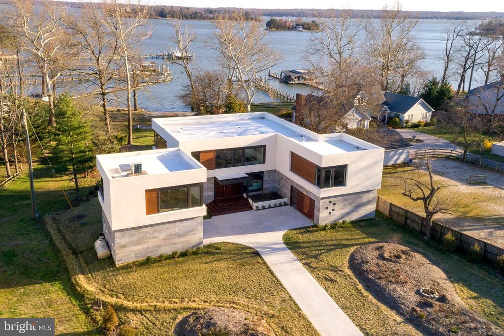 Rare Opportunity to purchase Recently Built Custom Waterview~ 4 Bedrooms 4.5 Bathrooms including potential First Floor Ensuite! Oversized contemporary casement Wall of Windows in open main level providing glistening views of Sillery Bay. High-end building materials and energy efficient mechanical systems.Commercial grade TPO Membrane solar ready roof with conduit installation. Stunning finishes including Brazilian Walnut Flooring, Waterfall leather finished kitchen island, Steel Railing and Solid Wood Floating Staircase to name a few!  Detached Garage featuring second level Studio with Covered Waterview Patio. Access to Community Beach bordering property. A remarkable home with thought and attention to detail at every turn!