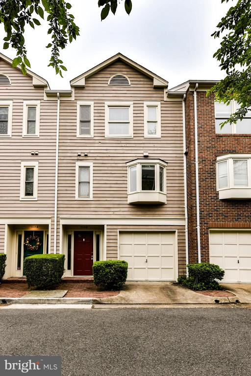 TWO BLOCKS from Ballston Metro stop.  Impeccably maintained with tons of new updates from mechanical to cosmetic.  1 car garage, 1 dedicated parking spot.  Gourmet kitchen with SS appliances, hardwoods on the main level, and updated bathrooms.  Clean, neat, and move in ready!
