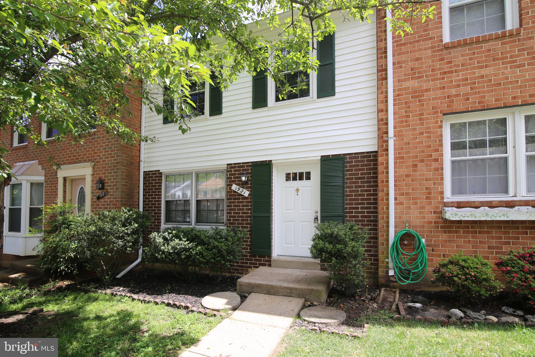 Immediate Occupancy!!This is a move in ready, well maintained  bright town house,  nestled on a tree lined street close to shopping, services and commuter routes.  The roomy eat in kitchen with good counter space and ceramic floors has  a  pantry and separate broom closet to compliment the nice cabinetry  for extra storage space. Pretty ceramic entry way is low maintenance. Contemporary light fixtures bring a modern flair to this house along with the vessel sink vanity in the powder room. The lower level sports  a big family room  with easy maintenance laminate floors.  There is also a large laundry room with lots of space for doing crafts or projects. Sliding glass doors lead to a private fenced rear yard with deep wooded views. Cardinal Title preferred.