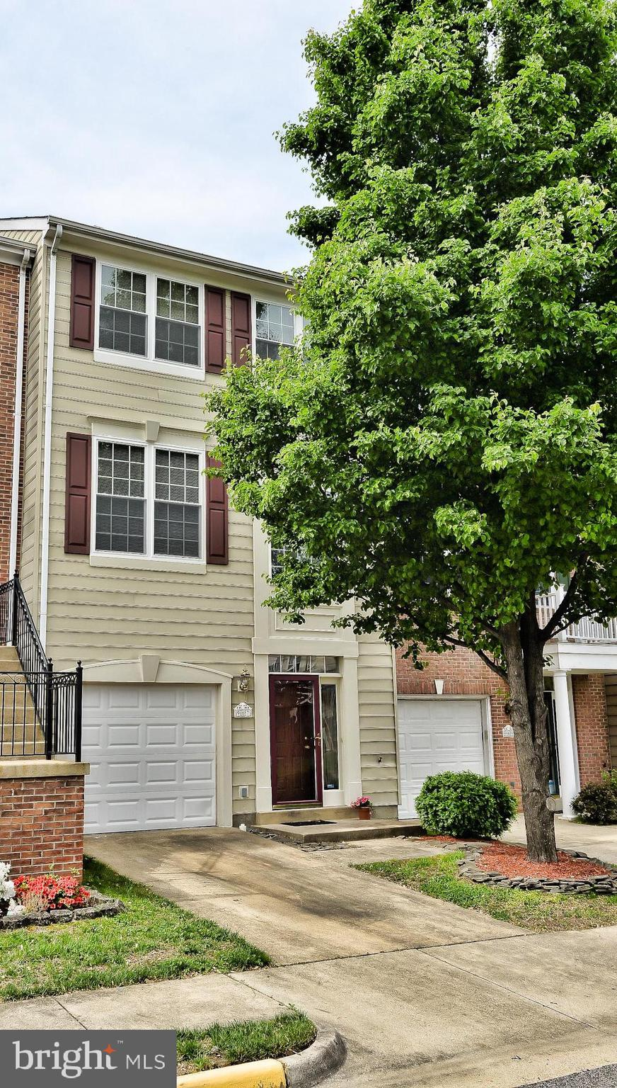 Commuter's dream!  Just blocks to VRE and minutes to OmniRide Express Bus to downtown DC & I95. This garage style town home is tucked in a quiet enclave yet enjoys all the amenities of Belmont Bay waterfront community at an affordable price.  Built-in's on every level, nooks and crannies provide tons of storage options.  Large kitchen with center island, granite counter tops and stainless steel appliances features a gas fireplace to cozy up with coffee on cold mornings or adult beverage after a long day.  This open kitchen space can be used as a breakfast room or family room and leads to a brand, new deck for grilling.  Hardwood floors on main level and palladium window offers tons of natural light.  Master bedroom with en-suite bath includes separate shower and soaking tub.  Lower level with family room & gas fireplace walks out to lower deck and newly stained privacy fence.  Front windows were replaced with Thompson Creek double pane.  HVAC system 3 yrs young.  Enjoy dining in nearby Occoquan, bike & jogging paths throughout the community & don't forget your binoculars for spotting osprey & a variety of wildlife in Occoquan Bay National Wildlife Refuge.