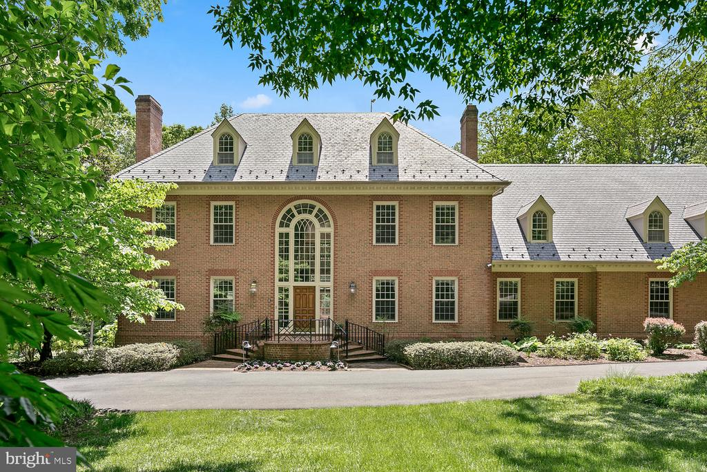 **LATE OPEN SUN 7/21 from 4-6 PM** Don't miss this opportunity to buy the best deal in Northern Virginia with this Large Price Reduction of 250K**A light-filled Williamsburg styled Colonial Revival mansion on a quiet country lane in Clifton, Virginia, is a picture-perfect, large three-story, brick house with another level below-grade, and has about 12,000 square feet of living space. The home has seven bedrooms, seven bathrooms and two half-baths. The current owner, added a three-car garage with an au-pair suite. Other improvements included four steam humidifiers, a whole-house vacuum system, two tankless gas water heaters, and extra attic insulation. Additionally, they installed a whole-house generator that can power the entire property including the pool.  An Otis elevator to all 4 levels. Come see this grand Southern facing Estate home that is only 2 miles from Interstate 66.