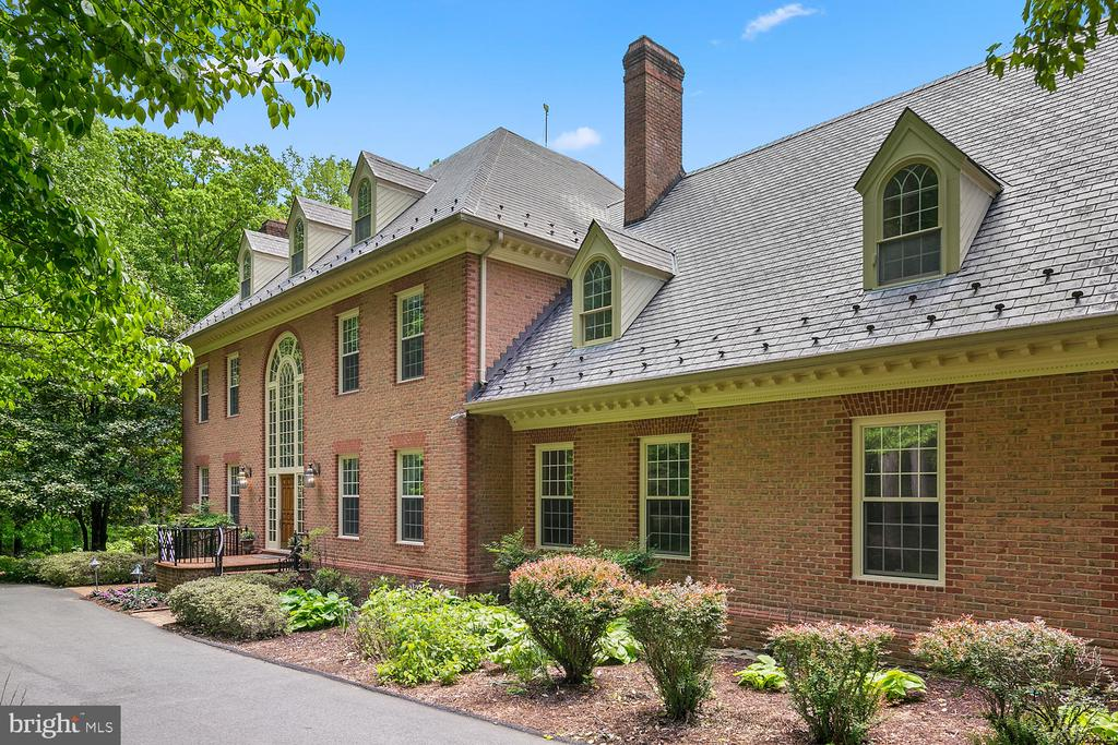 **Open House Saturday 11/9 1-3pm**Price Reduced and Back on the Market, so Don't miss this opportunity to buy the best deal in Northern Virginia** A light-filled Williamsburg styled Colonial Revival Mansion on a quiet country lane in Clifton, Virginia, is a picture-perfect, large four level, brick house with about 12,000 square feet of living space. The home has Six bedrooms, Seven full bathrooms and Two half-baths. The current owner, added an additional three-car garage with an au-pair suite upstairs. Other improvements included four steam humidifiers, a whole-house vacuum system, two tankless gas water heaters, and extra attic insulation. Additionally, they installed a whole-house generator that can power the entire property including the pool. An Otis elevator to all 4 levels. Come see this grand Southern facing Estate home that is only Two miles from Interstate 66.