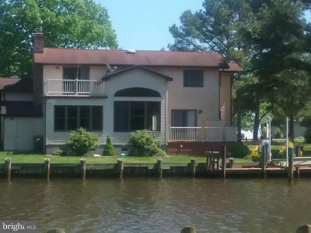 Beautiful, Large home with many recent upgrades and recent remodel/enlarged. Wonderful waterfront with Boat lift. Excellent views of Pintail Park across wide Canal. Property must be seen to appreciate the fantastic livability and space it offers. Also has a large walk in storage area as well as an outside storage shed! 2 car garage with work bench! Deck outside Master bedroom on 2nd. Floor /  Actually 2 Master Bedroom Suites!!One on first Floor!! Deck with Patio doors from Kitchen and also from Great room!!