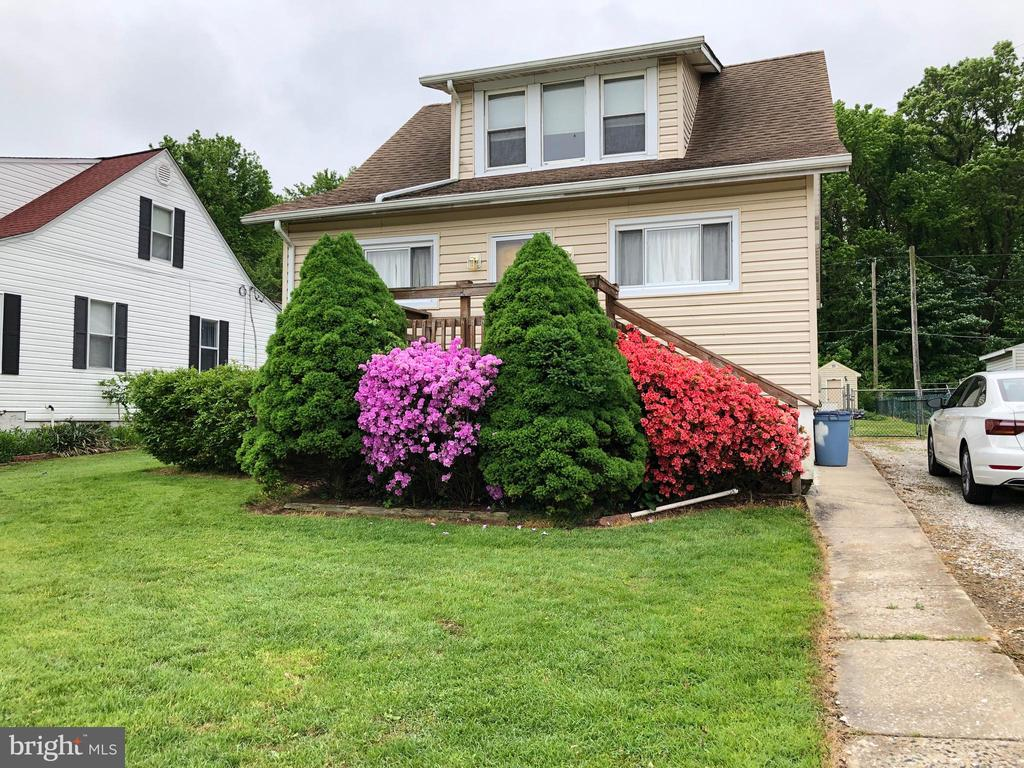 New Siding, Roof 10-12 yrs old, New Water heater, C/A 2 yrs old. Are you Handy? This  needs TLC, and UPDATING, Carpet allowance for 2nd floor. in Edgemere, across from Penwood Church. Quiet and Easy living. Paneled walls, updated kitchen,  1 bedroom on Main level, and, 2 additional bedrooms upstairs. Full unfinished lower level. Large yard level lot.