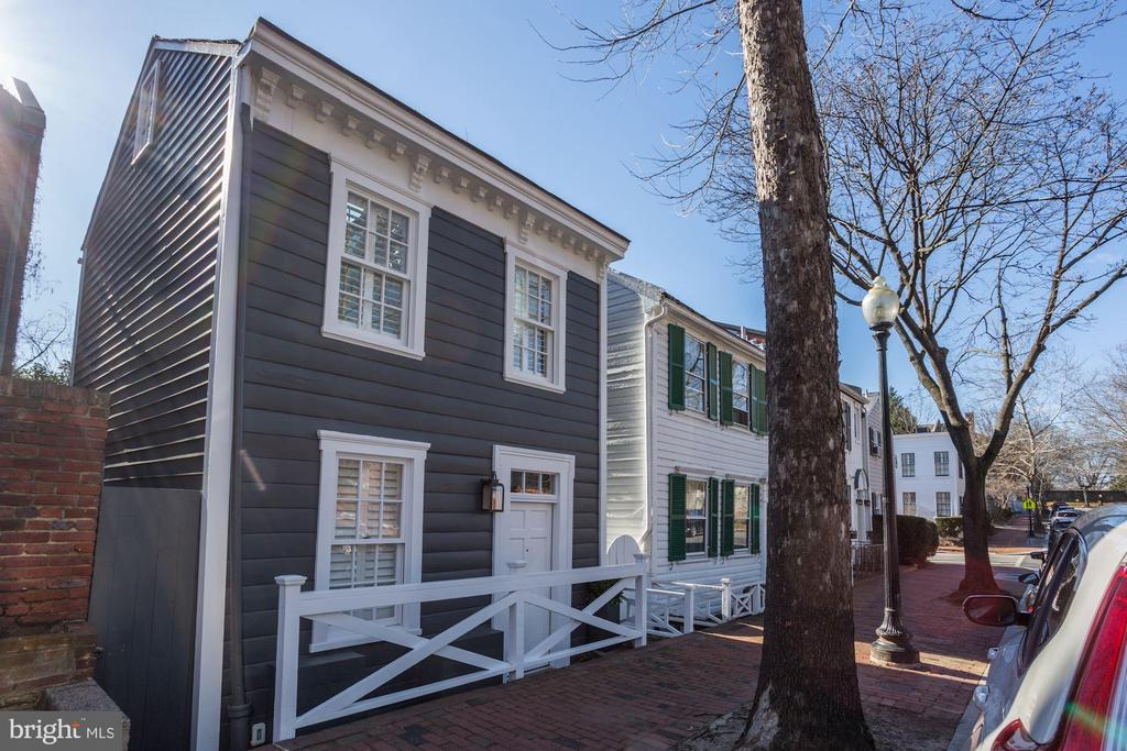 Fully Furnished & Newly renovated Historic Federal style home in Georgetown steps away from Georgetown University. The elegant casual interior with vaulted ceilings in the kitchen and master suite create a warm and spacious atmosphere.  The Living room and separate family room offer a variety of spaces to relax in. Fully equipped custom kitchen with marble countertops compliment the home.The cottage sleeps up to 6, two bedrooms (1 king and 1 queen) each with their own bathroom,  plus a queen sleeper sofa in the family room.1st Floor:Living room with gas fireplace.Vaulted ceiling fully equipped kitchen with gas fire place, seating for 6, SMART Flat screen TV. 2nd Floor:Vaulted ceiling  master bedroom with King size bed, walk in closet, ensuite bathroom with walk in shower, SMART Flat Screen TV.Ground Floor:Guest bedroom with Queen size  bed. Bathroom with walk in shower.Family room with Queen sleeper sofa and gas fire place, SMART flat Screen TV.Washer & Dryer Closet.Walk out to private landscaped backyard with outdoor dinning set.Central AC & HeatingHi speed Wi-Fi Available to move in on September 1st