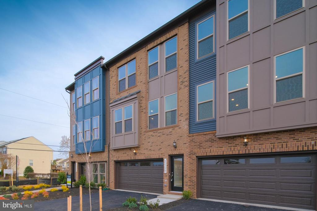 The Louisa offers a modern 2 car front garage townhome with all the luxuries you want in your new home. Your home will boast an upgraded rear deck with Timbertek and vinyl rails overlooking your own backyard and our own park. Designer details make this home a must have for anyone with style looking for an amazing location that's close to all the area's amenities and commuting routes.
