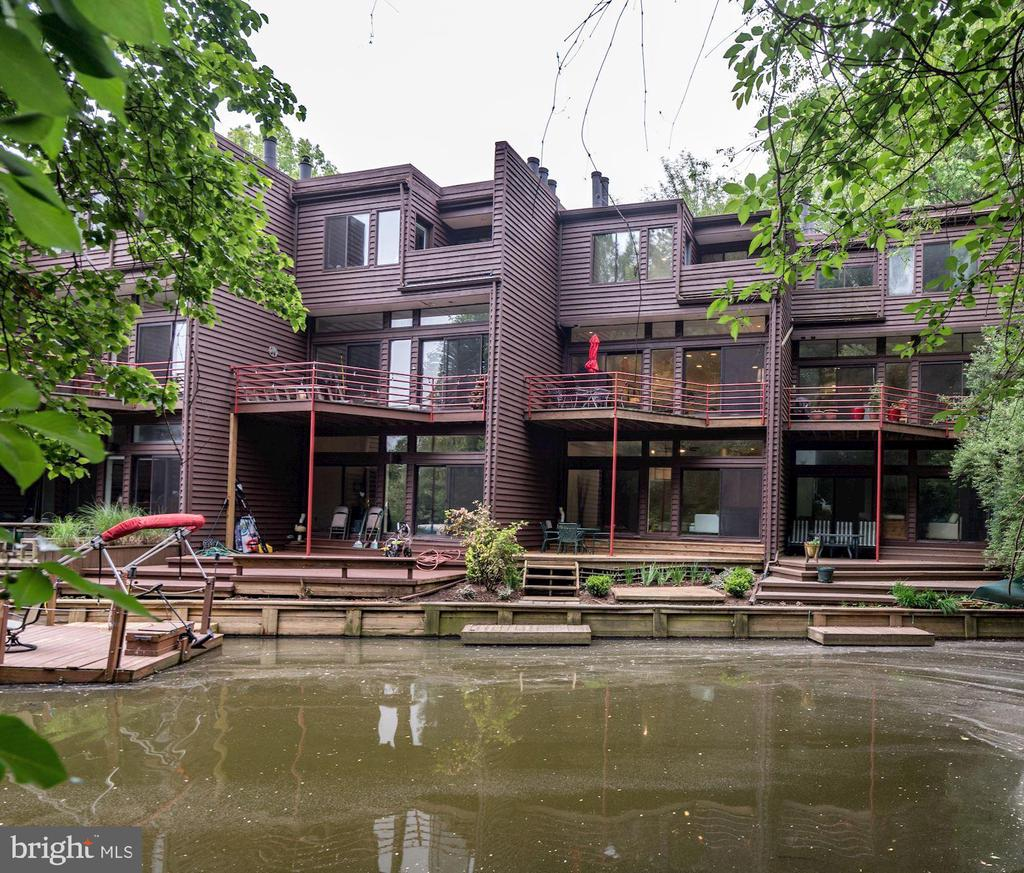 STUNNING,RENOVATED WATERFRONT GARAGE TH ! 3304 Finished Sq Feet! Soaring vertical interiors + open concept living! Large entertainment areas balanced by intimate spaces & cozy corners!  Walls of glass w/clerestory accents, decks overlooking water on 3 levels + interior atrium windows fill home w/light.  Striking UPDATED Kitchen with banquette, new SS Bosch appliances, stunning quartz countertops! Living room w/ tranquil views of water & woods + fireplace +custom built-ins.  Master suite w/ private deck & water views + sitting area + built-ins. Stunning REMODELED Master Bath w/dramatic 2-story ceiling, free standing bathtub, custom shower,dual vanities + walk-in closet! Upper 2nd level w/Loggia w/interior atrium windows, REMODELED 2nd bath & generous 2nd & 3rd bedrooms.  Expansive lower level:REMODELED 3rd full bath w/designer vanity, wet bar, spacious recreation room w/ 2nd fireplace, 9'+ceilings wall of glass opening to tiered deck w/direct access to water + large bonus room/4th bedroom. Tons of storage! AMAZING WATERFRONT HOME!  Incredible location -1.5 miles to Silver Line Metro/Wiehle Ave, Minutes to major access roads, boat/walk to shopping, close to Reston Twn Ctr! Tranquil, peaceful, well established lake side community + impeccably renovated, dynamic interior!