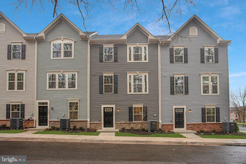 The convenience of townhome living meets the amenities of a single family home in Ryan's Neuman.  The sculptural staircase sets the tone of elegant simplicity and functionality that continues through the rest of the home.  On the main living level, an enormous Kitchen with island opens onto a bright and airy Living Room, perfect for entertaining. Upstairs are two spacious bedrooms with ample closet space, a hall bath, and a generous Owner's Bedroom that features a huge walk-in closet. For a truly spa-like experience, the separate Owner's Bath features a dual vanity and 5 shower with dual shower heads.   The attic is finished with an extra bath, large bedroom, and roof top terrace! The Neuman offers classic traditional facades and a 2 car garage. Prices/terms/availability subject to change. Photos Similar