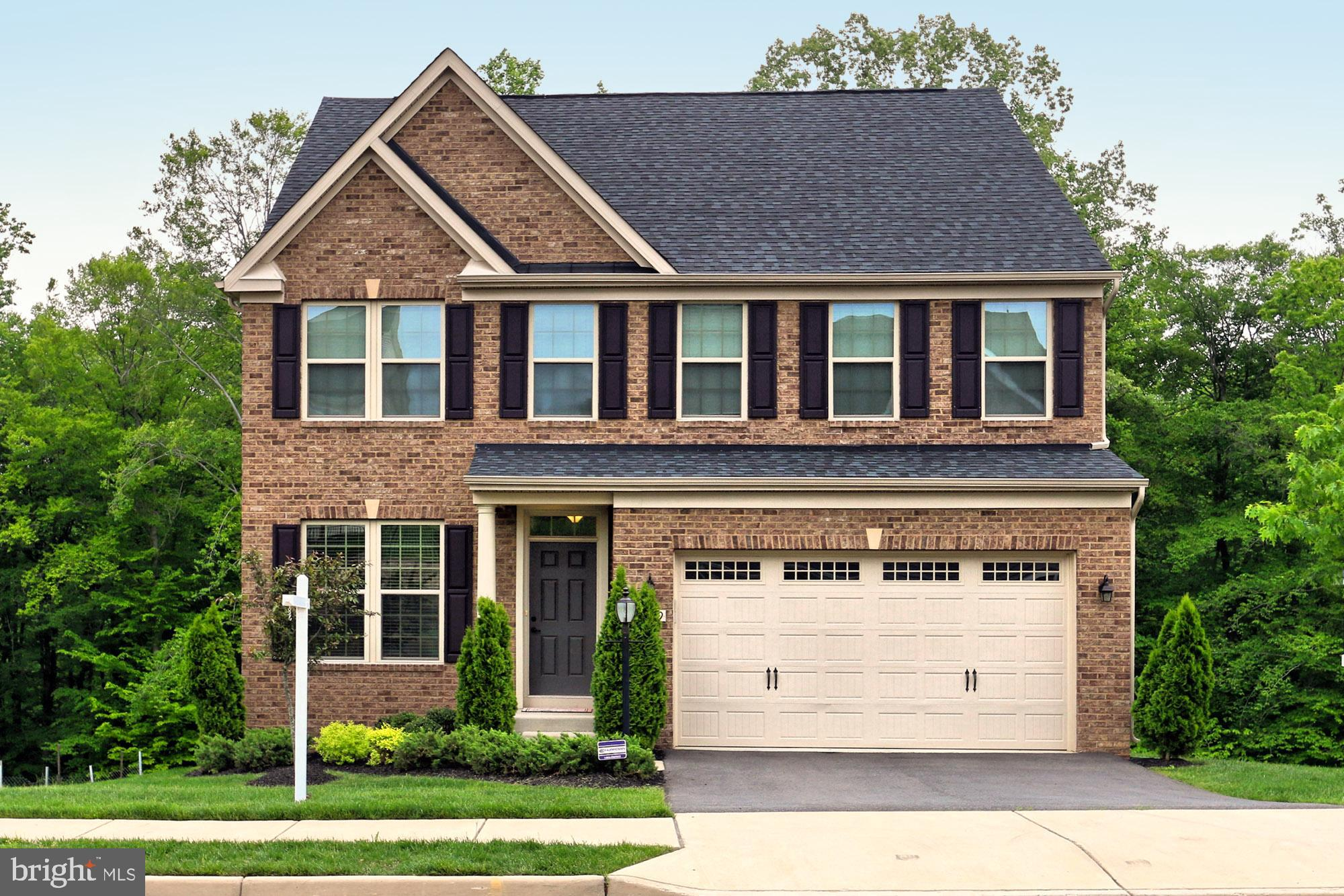 ** Stately Like New Brick Front Colonial Located On Premium Wooded Walk Out Lot! Over $100K in Builder Options! First Floor Study. Separate Dining Room. Family Room With Stone Gas Fire-place. Upgraded Gourmet Kitchen With Large Center Island. Morning Room With Eat In Area Walks Out To Private Trex Deck. The Upper Level Features An Upgraded Master Suite. Two Large bedrooms Share A Full Bath. The Laundry Room Is Conveniently Located On The Upper Level Too! Lower Level Features The Fourth Bedroom, Full Bath, Large Rec Room, Wet Bar and Theater Room! The HomeTheater Is Equipped With A $3000.00 Bose Lifestyle System. Both The Great Room And Rec Room Have Wireless, Concealed Speakers That Will Access Your Favorite Music From A Smart Phone Or Computer. The Walk Out Lower Level Provides Plenty Of Light And Flexibility. Colgan High School District!