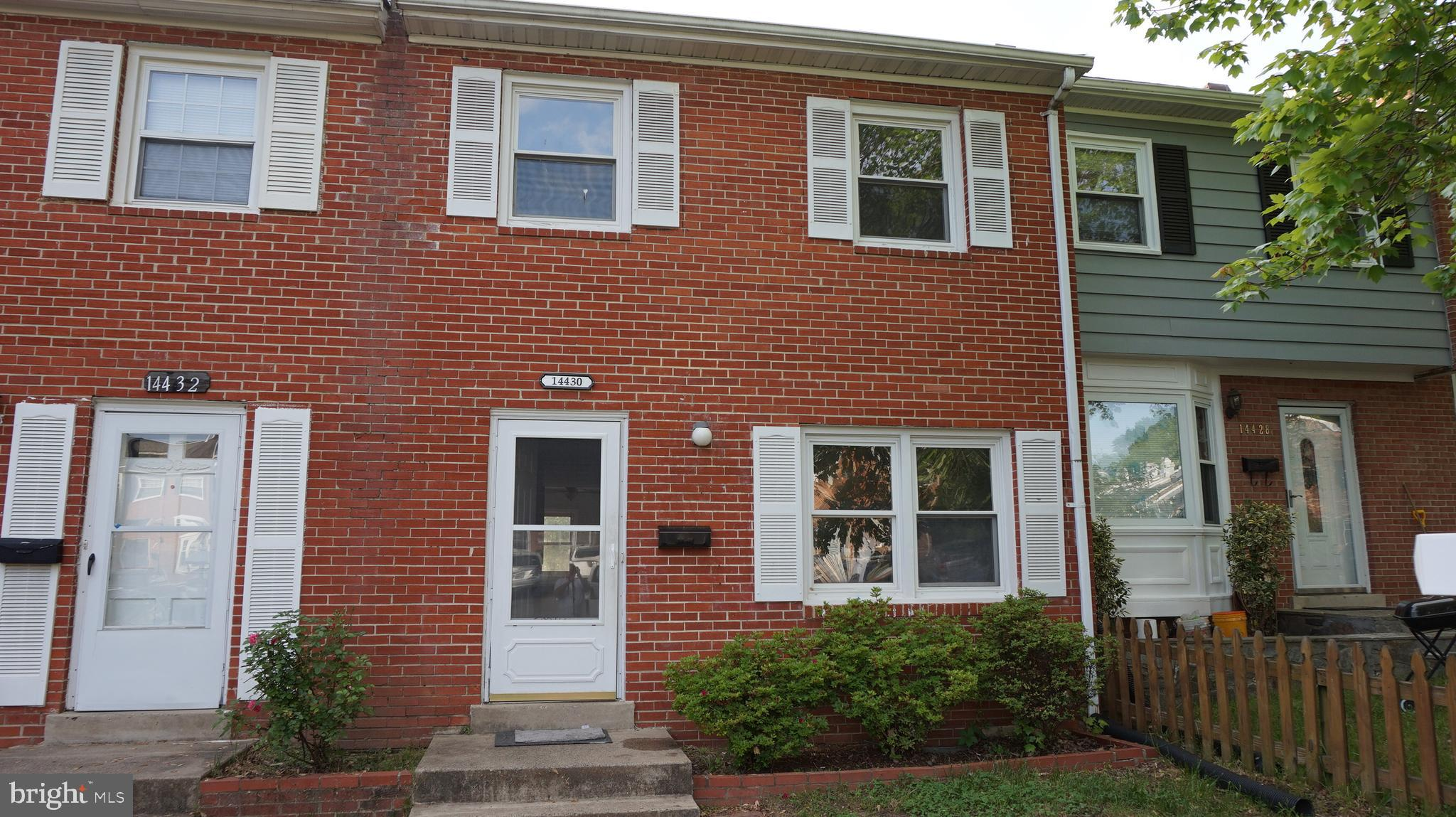 Fantastic opportunity to own this very spacious town house. The home shows very well with gleaming refinished hardwood floors and fresh paint through out. The large kitchen comes with stainless steel appliances and gas cooking. Dishwasher and disposer have been just replaced.  All the appliances and the furnace and air conditioning have been replaced. The basement is a walk out and is fully finished and comes with wood burning fire place. The basement also includes a full bath and finished den. The back yard comes with paved patio and fully fenced yard. You will love the space this home is bigger than you think!!