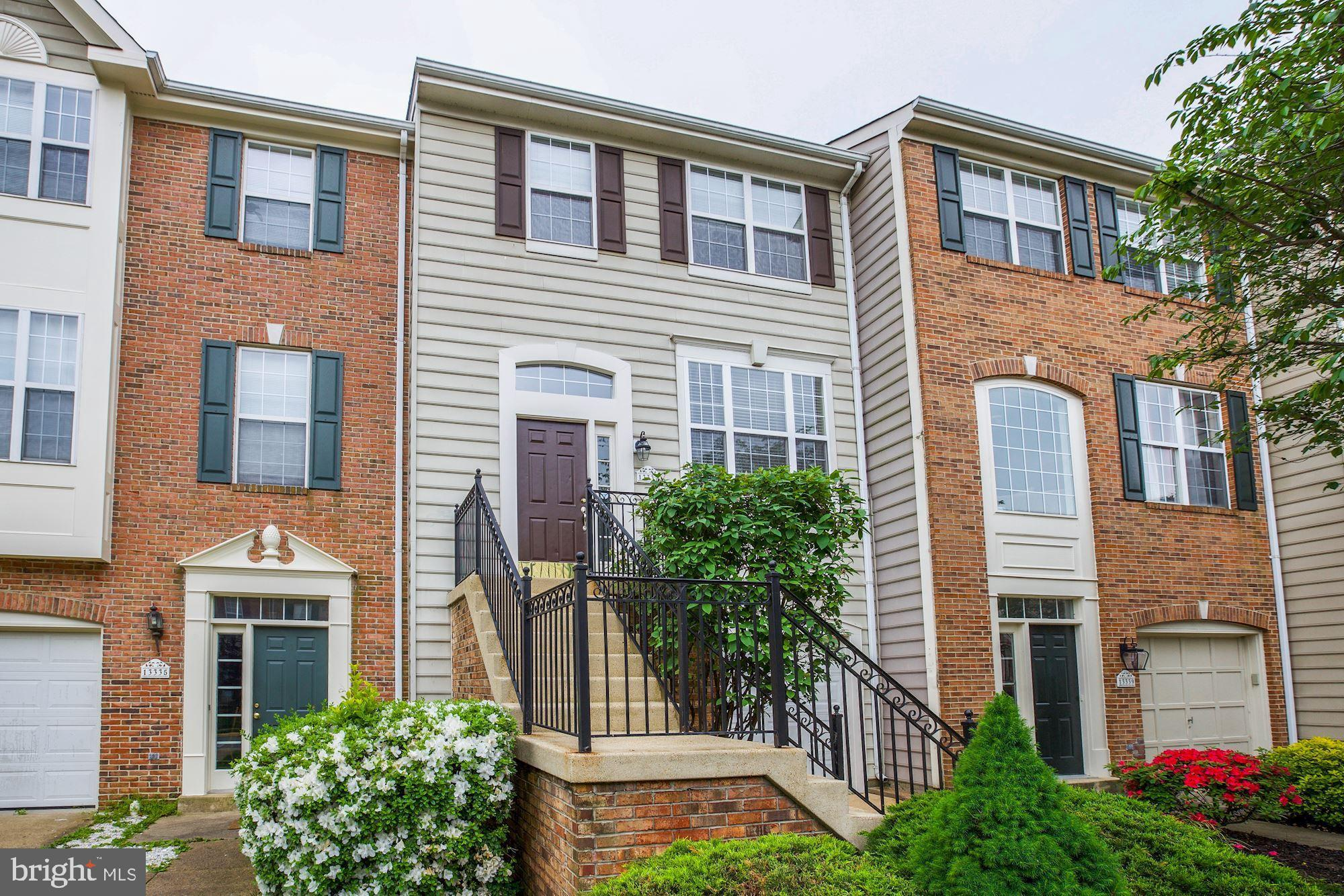 DON'T RENEW that lease! Come and live on the Occoquan River in this move-in ready townhome in sought after Belmont Bay! Easy-peasy commute with the VRE a stone's throw away makes getting to the Pentagon or DC relaxing. Ideal for Ft Belvoir and Quantico commuters too. This home is clean, bright, and open! Ready for you with all new flooring on all three levels, wood in foyer, kitchen, and family room!  Spacious rooms welcome your comfortable furniture. Family room off kitchen with gas fireplace, and entertainment center rough-in.  Kitchen has new granite countertops, new faucet, and new refrigerator.  Sliding glass door to the oversized deck is the perfect spot for July 4 grilling! Master bedroom has walk-in closet, luxury bath with separate soaking tub, separate shower, and double vanity sink. Finished lower level has oversized rec room, laundry room with full sized washer and dryer that convey.  Walkout to fenced in back yard.  What a beautiful community, what a beautiful home.! Make Belmont Bay home today!