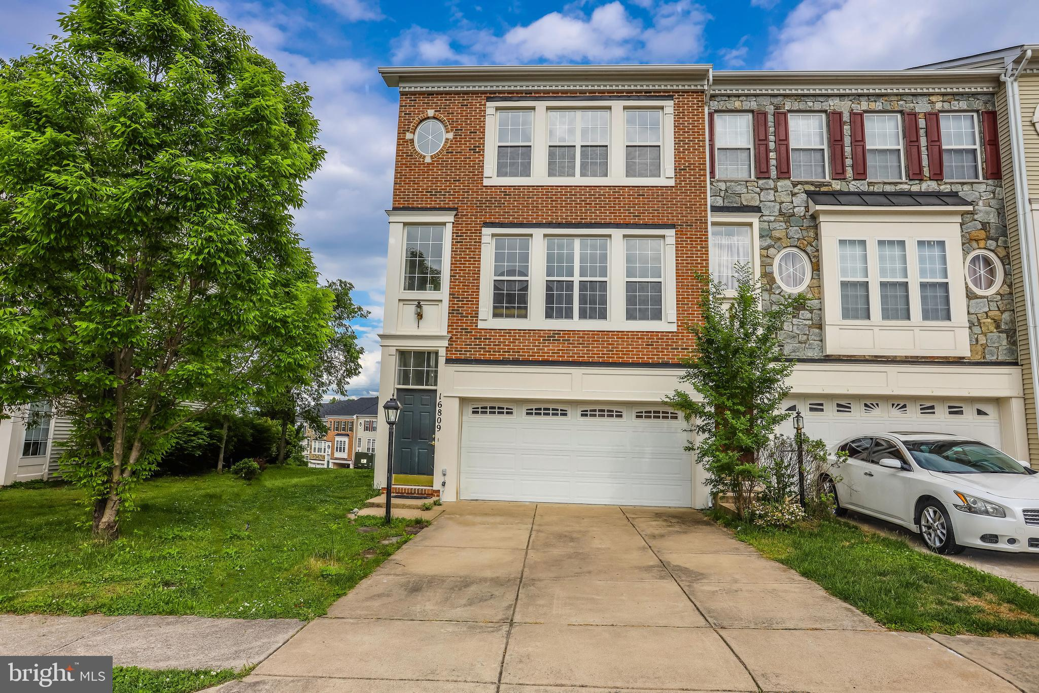 Open house 5/12/19 from 1PM to 4PM ~ WILL NOT LAST LONG! Spectacular end unit town home Freshly painted end-unit townhouse with 2 car garages. New carpeting on the third-floor bedroom level, and hardwoods on the main level. Hardwood flooring have been newly refinished. Open floor plan! This home radiates with natural light. Open foyer, that ascends to an open dining room and living room. The kitchen has stainless steel appliances, with granite countertops, and double atrium doors that are ready for a deck. Enormous basement space and walk out level basement.