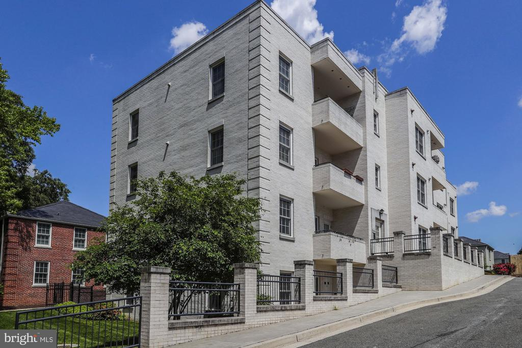 Offers, if any, Thursday 05/16 at 6pm. Super value for this 2BR/2BA condo with private patio and entrance in hot Ballston! Freshly painted, kitchen with granite, SS appliances and maple cabinets. Two real bedrooms, each with their own bath. Washer/Dryer in unit.  Pets allowed. Walk to the new Ballston Quarter Mall, Ballston metro and Harris Teeter. This condo comes with a dedicated parking spot. Please note - pictures are virtually staged. Don't miss it!