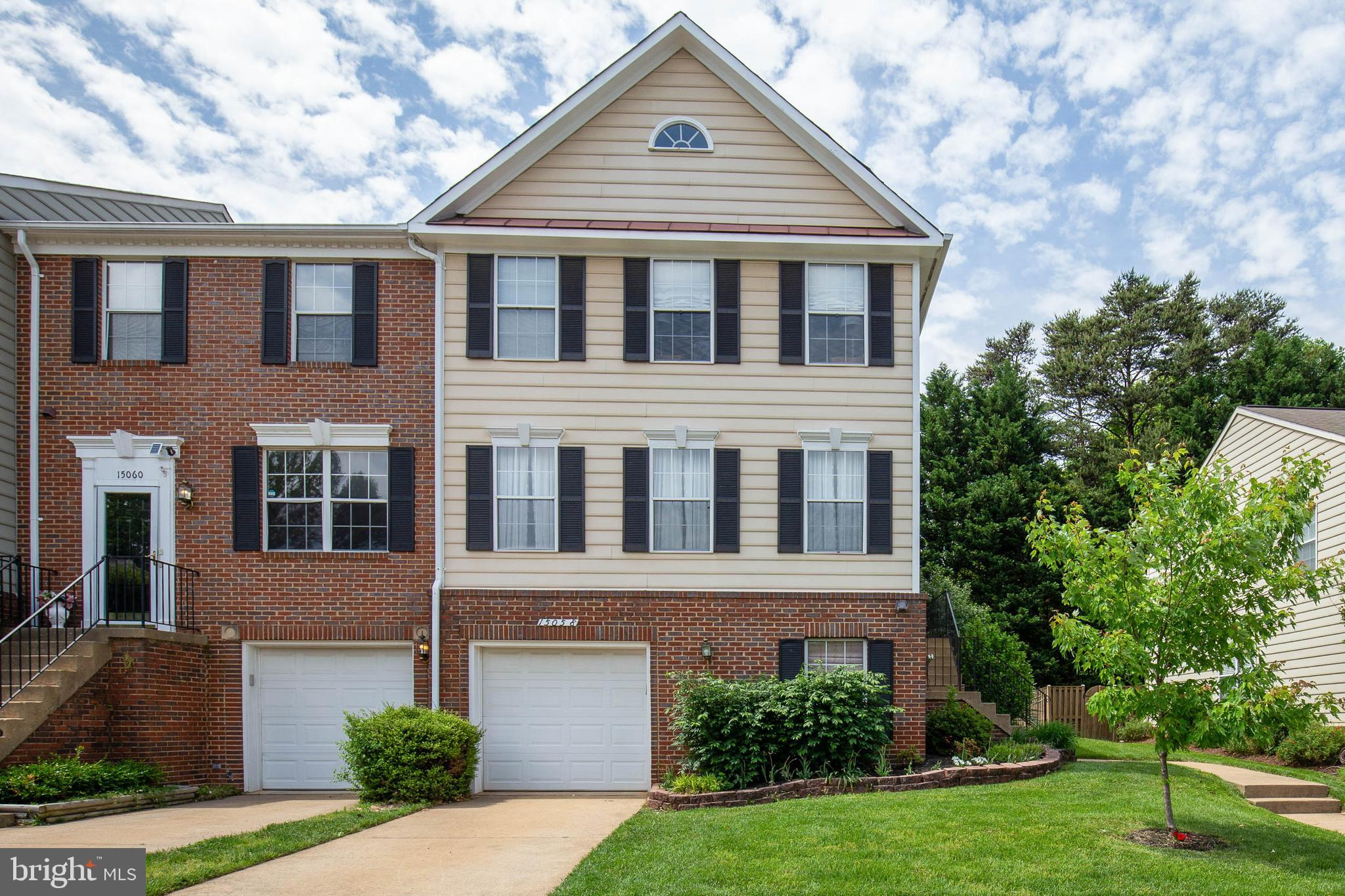 3BR 2/1BA end unit townhome with 1 car garage. Main level hardwood. Updated kitchen has butcher block counters, updated appliances, 5 burner gas stove, pantry. Lower level rec room and laundry, rough-in bath. HVAC 2013. Deck. Privacy fence. Backs to trees.