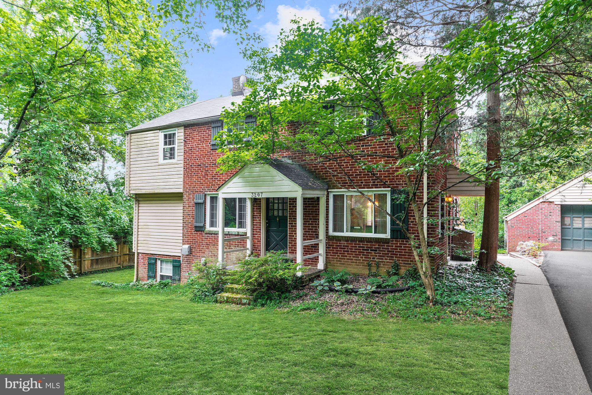 Your retreat just outside of the city, this beautiful colonial style home will be your private oasis! Minutes to shopping, restaurants, parks and metro stations you can't beat the location. Sitting on an oversized lot backing to trees, enjoy dining al fresco on the large and sunny back deck. Curl up with a good book in front of the fireplace in the living room or have your morning coffee in the bright and inviting sunroom. Upstairs the master bedroom has wooded views and a private sitting room with walk in closet. This home has incredible potential and ready for you!