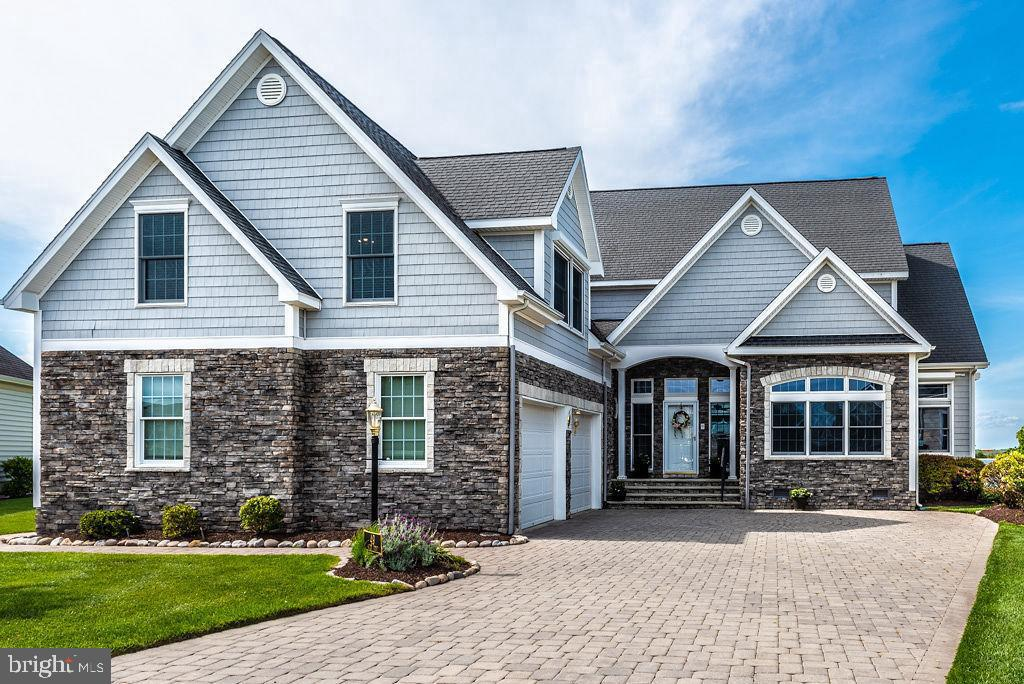This is the waterfront home you have been waiting for! Exquisite ~Coastal Style~ custom home built by premier builder/owner. Point lot in Tern's Landing with magnificent panoramic views of the open bay and Ocean City bridges. You will appreciate the quality from the stone accents on the exterior, paver driveway and lush landscaping and the interior has all the bells and whistles and more. Super-efficient Geothermal heating and cooling for substantial energy savings. This home has many unique upscale features not seen in most homes. Separate entrance to large living area over garage. Lots of upgrades including custom Andersen windows, coffered and raised or vaulted ceilings throughout and gorgeous trim detialing. Each bedroom has its own bathroom and all 4 bedrooms can be used as the master . Several bedrooms have private sitting areas. Three outdoor decks and a patio, plus a front porch for outdoor entertainment/enjoyment. Boat dock with lift for summer fun and easy access to the ocean for fishing. Large entry foyer, hardwood flooring in great room and adjacent den. Separate formal dining room. Very well maintained home and grounds with lawn irrigation. Large point lot at end of quiet cul-de -sac with great settings for watching the sunrises. Owner will provide a one year warranty to buyer. Enjoy all the community of Ocean Pines has to offer including Yacht Club and restaurant, 5 swimming pools (1 enclosed), Robert Trent Jones golf course, marina, Community Center, Beach Club on the ocean, community police and fire departments, skate park, dog park, playgrounds, walking / biking trails, indoor gym, racket center with 8 pickle ball courts.