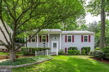 A Perfect Combination! Appealing exterior curb appeal and  lovely ambiance and decor in the interior! This lovely split has been immaculately cared for and beautifully updated throughout.   A spacious living room or (dining room) with gleaming hardwoods & is filled with light.  The kitchen has been opened up, extra cabinetry has been added and opens to the dining area or family area- A perfect place to relax and enjoy quality time with friends or family- and then out to the large deck for outdoor enjoyment.  A master retreat with sitting room with incredible built-ins and closet space beyond compare + private updated bath!  The other bedrooms have been reconfigured with additional closet space.  Lower level boasts of a huge rec room with fireplace & double windows to let in the light and opens to a spacious game area as well...What a great place to play!  A 4th bedroom and full bath on this level as well! Do you need a workroom and/or a huge area to store items?   ..Spread out & enjoy! Don't miss the outdoor storage area off deck.                                                                                                                                                                                                  Perfect Location too:  Close to numerous transportation opportunities including metro!  2 neighboring parks as well!  Grab the keys-  Open Sunday the 19th 1-3:30...