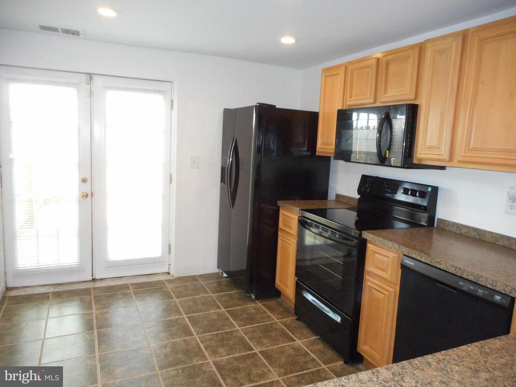 FOR ALL INVESTORS, THE RENT IN THE IMMEDIATE AREA IS UP TO $1600 PER MONTH.    PROPERTY IS READY FOR YOU TO PUT YOUR TENANTS IN!  DRASTIC REDUCTION TO HELP YOU GET INTO YOUR NEW HOME! MOVE IN READY! THE OWNER HAD THE PROPERTY , CLEANED, PAINTED & RENOVATED, JUST FOR YOU, THE NEW OWNER.  THIS 1536 SQ FT. UNIQUE PROPERTY HAS A DECORATIVE FIREPLACE IN LR, ALONG WITH EXPOSED BRICK & HARDWOOD FLOORS, CERAMIC TILE IN THE KITCHEN, WITH ALL NEW BLACK APPLIANCES, THEN HEAD OUT INTO THE SHADED BACKYARD WITH A PRIVACY FENCE, WHERE YOU CAN COOK OUT WITH YOUR FRIENDS & FAMILY. THERE IS EVEN A PARKING PAD RIGHT OUTSIDE THE FENCE.  THEN HEAD BACK IN, UP THE BEAUTIFUL SPIRAL STAIRCASE LEADING TO 2 MASTER BEDROOMS WITH NEW CARPET, NEW BLINDS & UPDATED BATHROOMS. A SITTING AREA AND A PATIO OFF THEM BOTH. RECESS LIGHTING THROUGHOUT. HEAD BACK IN, DOWN TO THE FINISHED BASEMENT TO BRING YOUR BACK GATHERING INSIDE. THERE IS EVEN A HALF BATH. IF YOU LOVE CITY LIVING, CLOSE TO EVERYTHING, THIS HOUSE IS FOR YOU.  THERE IS A REVITALIZATION GOING ON IN PATTERSON PARK, DON'T MISS IT.  DON'T FORGET, YOU CAN USE THE GRANTS, LNYW- WALKING DISTANCE TO JOHN HOPKINS, BALTIMORE CITY GRANT AND MORE. PRICE ADJUSTMENT!