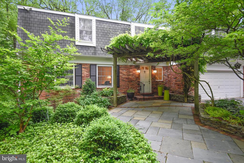 Perfectly charming, impeccably maintained 3 Bedroom 3/1 Bath Dutch Colonial on quiet country lane in the heart of Ruxton. Marble Foyer, Living Room w/wall of built-ins, formal Dining Room. Kitchen w/Rutt cabinetry & Corian counters flows to Family Room w/fireplace, built-ins & open flow to Sun Room. Expansive Master Suite w/Spa Bath & cozy Sitting Room w/fireplace & sliders to private balcony. Bedroom level Laundry. Walk-out lower level Rec Room w/built-ins, Bonus Room & full Bath. Elevated Deck, Patio & lush gardens