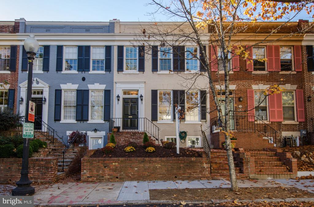 Beautiful 3BR, 2.5BA in the East Village! Bright Living room and Dining room w/ high ceilings and a bay window. Kitchen features Subzero refrigerator, Miele dishwasher, GE double oven. Lovely rear brick patio. Convenient 1/2 BA on the main level. Wood floors through-out the 1st & 2nd levels.  Large master BR w/ spacious closets. Full bath features soaking tub w/air jets & marble floor. Finished lower level w/ full BA. Walk to Montrose Pk, Georgetown retail & shops. Pets allowed case-by-case. Application fees apply. Smoking is not allowed on the property.