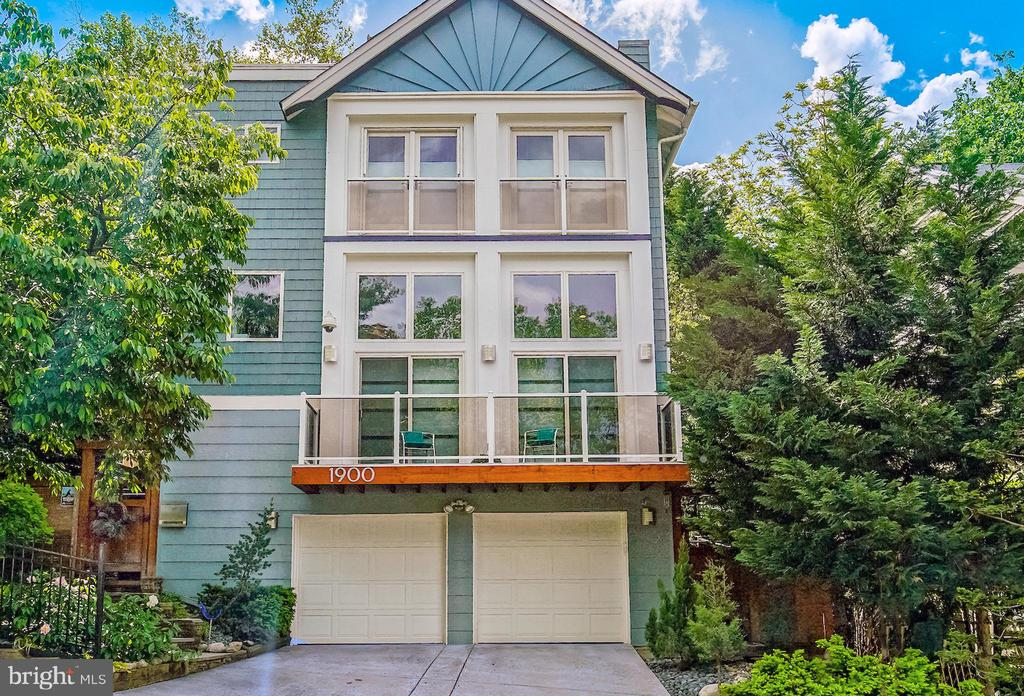 ONLY 3 BLOCKS TO COURTHOUSE METRO -  Fabulous Frank Lloyd Wright-inspired 4BR/3BA detached home with open, airy and modern interior in amazing location.  In close proximity to parks and trails, and a short walk across the river into historic Georgetown or a bike ride to Downtown DC with all the national monuments and museums.  Walk for all errands, and only steps to MOM's Organic Market.  Short and easy walk to restaurants, cafes, gyms and yoga studios, and Whole Foods and Trader Joes too.  Minutes to Reagan National Airport and quick trip to Dulles International Airport.  Easy access to all the wonderful, lively entertainment the Washington Metro Area has to offer.  The architecturally innovative design by INVISION's Eric Ritland with light flooded interior, clean lines, open spaces, sleek eye-catching finishes and attention to detail delivers a WOW factor as you enter the home from the peaceful Japanese-inspired courtyard garden perfect for outdoor entertaining, with multiple cherry blossom trees and Japanese Maples, staggered horizontal cedar fencing, serene sounds of a waterfall over a Koi pond surrounded by mature river birch and mature specimen plantings, providing complete privacy from the surroundings, making you think you entered a parallel universe.  This one-of-a-kind home expands over 3 levels (+ mezzanine dining room level) with a large ground level entry foyer, an entry-level bedroom overlooking the courtyard Zen garden, a full bathroom and inside access to an oversized two car-garage with built-in storage closets, epoxy-coated floors, extra refrigerator and two additional surface parking spots just outside the garage doors. The layout of this magnificent and impeccably maintained home offers all the comforts of a true home with the refinement and tranquility of contemporary living. The mezzanine dining area overlooks the open cathedral-height living area with two French doors covered by shoji screens, leading to a sun deck featuring Brazilian hardwood