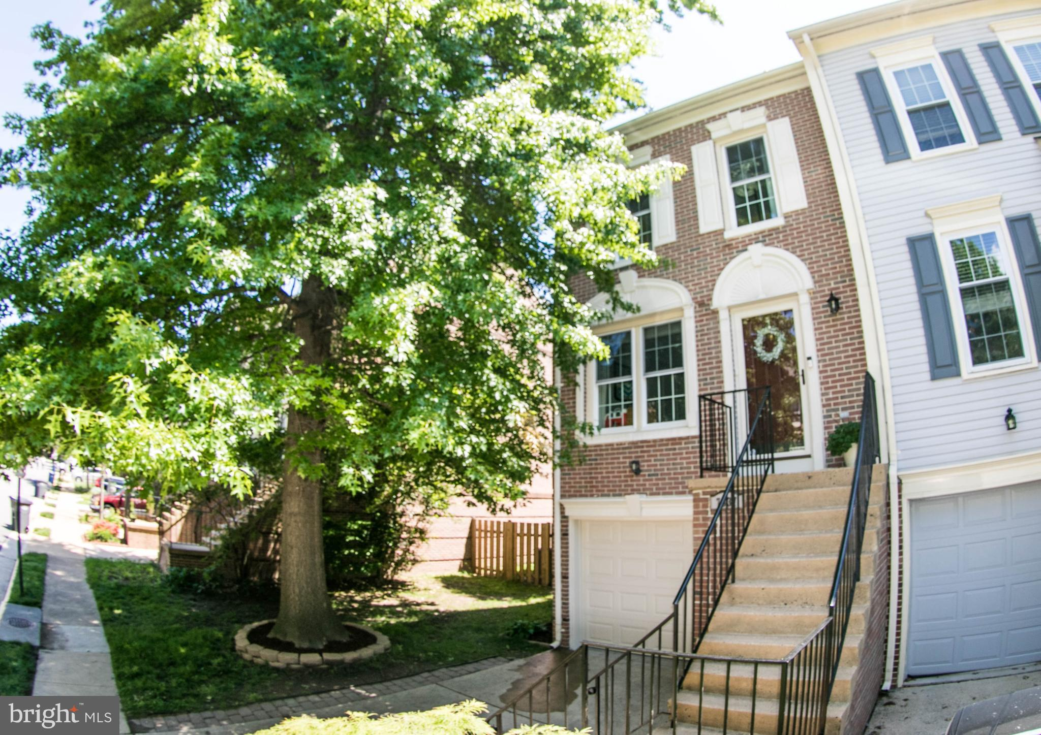 Beautiful Sunlit 4 level Brick Front End unit with amazing back yard.  Updated Kitchen and Master Bath room.  You'll love the deck just off the kitchen for grilling out and the prive fully fenced back yard.  Inside you will find 3 spacious bedrooms and basement space with tiled flooring and walk out to back yard.  Windows replaced in 2015.  Convenient to both Fort Belvoir and Old Town Alexandria, close to Shopping & Huntington Metro.
