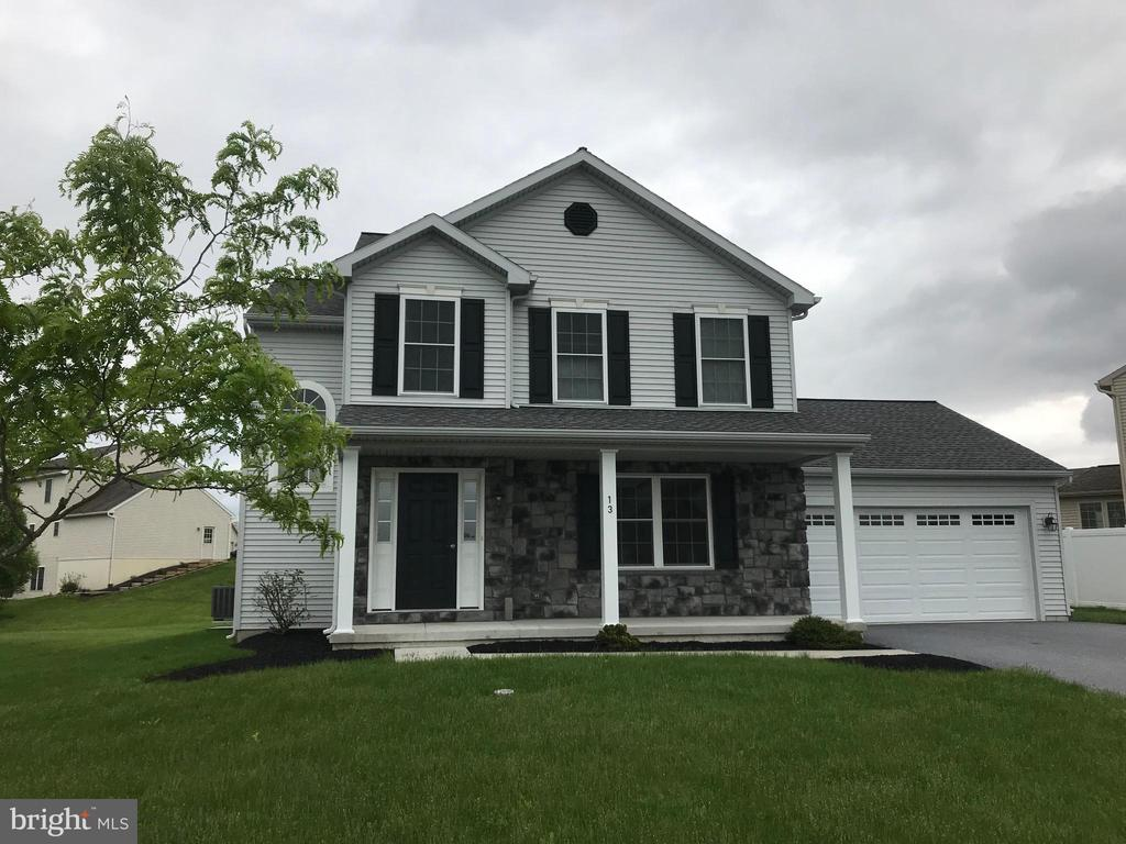 Like New 2 Story. Great kitchen with island, granite counter-tops, 14x12 sunroom. Gas fireplace in family room. Unfinished basement with egress window. Nice setting with deep lot.