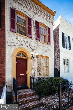 Enchanting East Village charmer! Quintessential Georgetown row home with 10 ft Ceilings, Gourmet Kitchen, Wood burning Fireplace, and french door access to a deep, mature planted garden. An easy stroll  to everything in Georgetown and Foggy Bottom, while still feeling a world away. A perfect city escape and condo alternative. The expansive rear garden offers great potential for expansion.