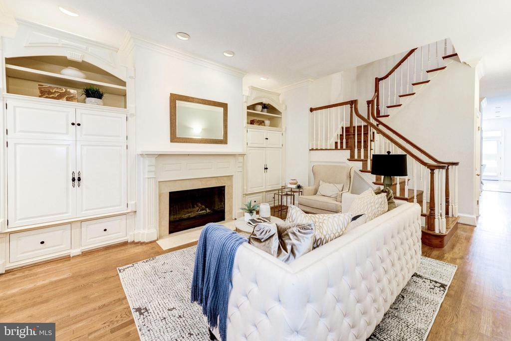 Great new price!  Ideally situated between West End and Dupont Circle, this 4 BR/4.5BA row house with in-law suite is within walking distance to Georgetown, the Central Business District, and two Metro stations. The living room features a bay window,  custom cabinetry and gas fireplace,  adjacent to a formal dining room, and a large gourmet kitchen with access to a rear patio and two car parking.  A powder room completes this level. The third level features a bedroom with en-suite bath, an additional bedroom, and a hallway bath.  The top-level features a huge Master suite with vaulted ceiling, a wood-burning fireplace, private balcony, and luxurious master bath with dual marble vanities, walk-in shower, and a Jacuzzi tub. Additionally, the basement level is designed as an in-law studio with a full bath, kitchenette, W/D hook-up, and a separate front entrance.   Easy walk to top restaurants, numerous health and sports clubs, Rock Creek Park, Kennedy Center, GWU, Trader Joe's and other fine establishments.    Buyers who choose KVS Title will receive a $500 credit at closing.  Note that this home was fully re-constructed in 1988, allowing for a more solid structure than most of the period row homes in the area.  Available for sale or rent.