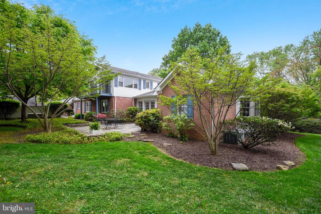"""Come view this private oasis on 1.5 acres just over the line in Baltimore County w/4 BRMS & 3-1/2 baths on private Gentry Lane-Numerous additions over the years has created over 4000 sq ft of flexible living space that can accommodate many different lifestyles-A 1st flr family rm w/beamed, vaulted ceiling w/floor to ceiling windows & awesome views-3 extra 1st flr living spaces-2 wood burning FP's-Multiple zones of heat & CAC-Relax on the stone patio or spacious screened porch-2 yr old furnace-A 2 car carport + a paver driveway w/space for multiple cars-Beautifully maintained-Old barn in """"As-Is"""" condition-A propane powered generator is also included."""
