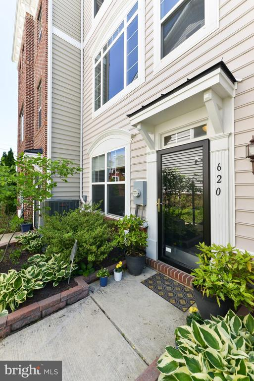 Beautifully maintained, bright & airy single-family townhome in convenient, quiet, developing N Michigan Park / Fort Totten / Brookland neighborhood.  Very recent systems (HWH 2018; heating & cooling 2016) and appliances (2009-2016).  Open kitchen with upgraded stainless steel appliances (GE Profile, Bosch), granite counters, island with space for stools, and extra table area.  High ceilings.  Big windows. Hardwood floors.  New carpets on upper level.  XL 1-car garage. Balcony with space for a grill plus table & chairs.  Short walk to Metro, parks, rec centers & Art Place (2M SF project featuring residential units, Aldi grocery store, Meow Wolf art exhibit space, Explore! kid museum, retail, restaurants, outdoor areas & more)