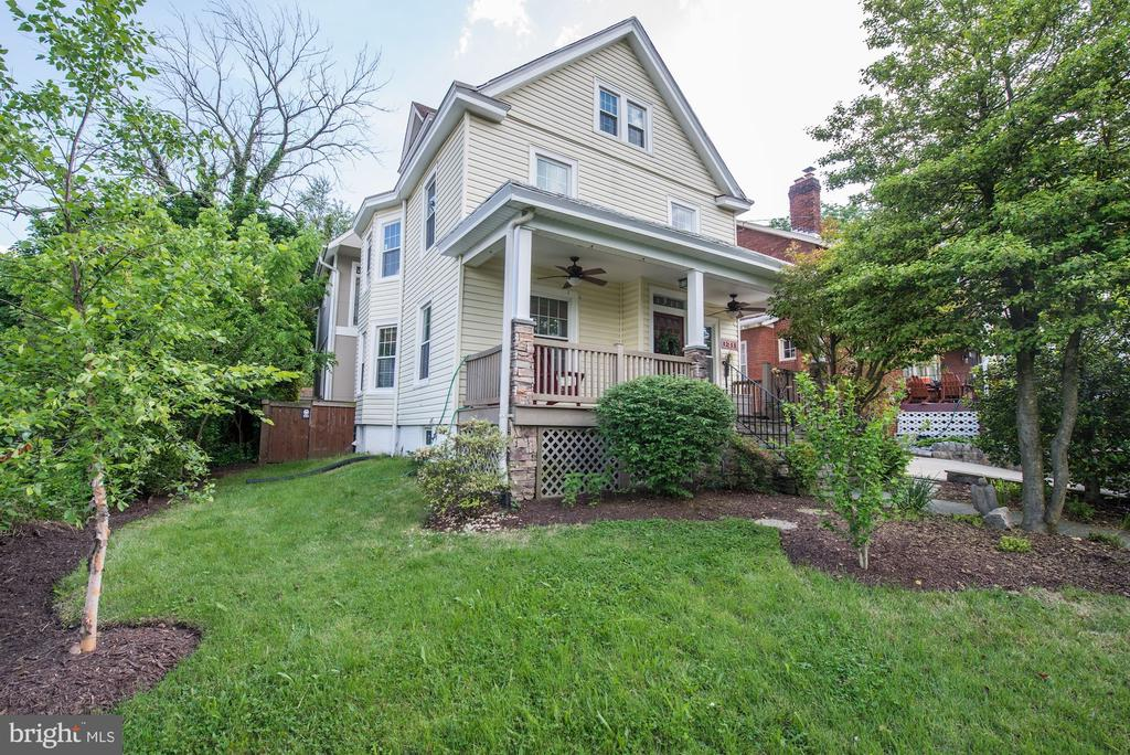 The best of both worlds - Farmhouse charm and a contemporary addition creates multiple living spaces in this urban oasis. Ideally located in the vibrant and diverse Brookland neighborhood, this property is just steps to shops, restaurants, parks, amenities, and a short walk to Metro. Original features combine perfectly with modern upgrades and amenities on all four levels of this truly one-of-a-kind home. Five bedrooms and four baths provide plenty of space for everyone. The recently updated kitchen and open plan are great for entertaining, and the upper level bedrooms and expansive master suite offer escape and privacy. The basement includes a big open space, laundry area and a full bathroom.  On the main level in addition to the kitchen, living and dining rooms, there is a private in-law suite with separate entrance. It comes complete with kitchen, living space, bedroom and a bathroom.  The upper level has 3 bedrooms, two bathrooms, and a sitting area.  To finish it up, there are 2 attics for extra living space.  Add the beautifully landscaped yard and front porch, and the two rear balconies for nearly year-round outdoor enjoyment. This home has it all!