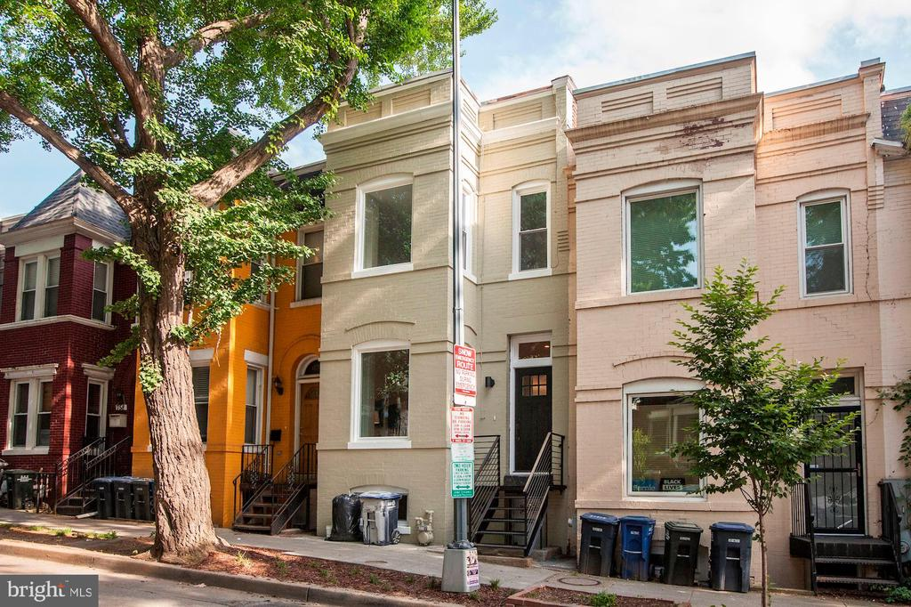 **OFFERS PRESENTATION DUE ON TUE 5/21, 3 PM**Magnificent Luxury Renovation in Columbia Heights DC**This is an amazing renovated 3 bedrooms, 3 and a half bathrooms townhouse with the ultimate improvements in lifestyle and all the convenience of city living. This gem built in 1908 and completely remodeled in 2019 features a contemporary style, open floorplan, 3 levels, fenced back yard, and potential rental income.The main level features open floor plan, hardwood floors, powder room, modern renovated kitchen, stainless steel appliances, granite countertops, backsplash, 42~ white cabinets, recessed lighting, and access to brand new patio, and fenced private backyard. The upper level includes hardwood floors in all 3 bedrooms, renovated hallway bathroom, master suite, bathroom with shower and tankless toilet, skylight in hallway, washer and dryer.The lower level is a front walkout basement with large family room, full bathroom and potential fourth bedroom for in-laws suite. Close to shops, restaurants, DC USA mail, yellow and green METRO lines, and all Columbia Heights vibrant nightlife.